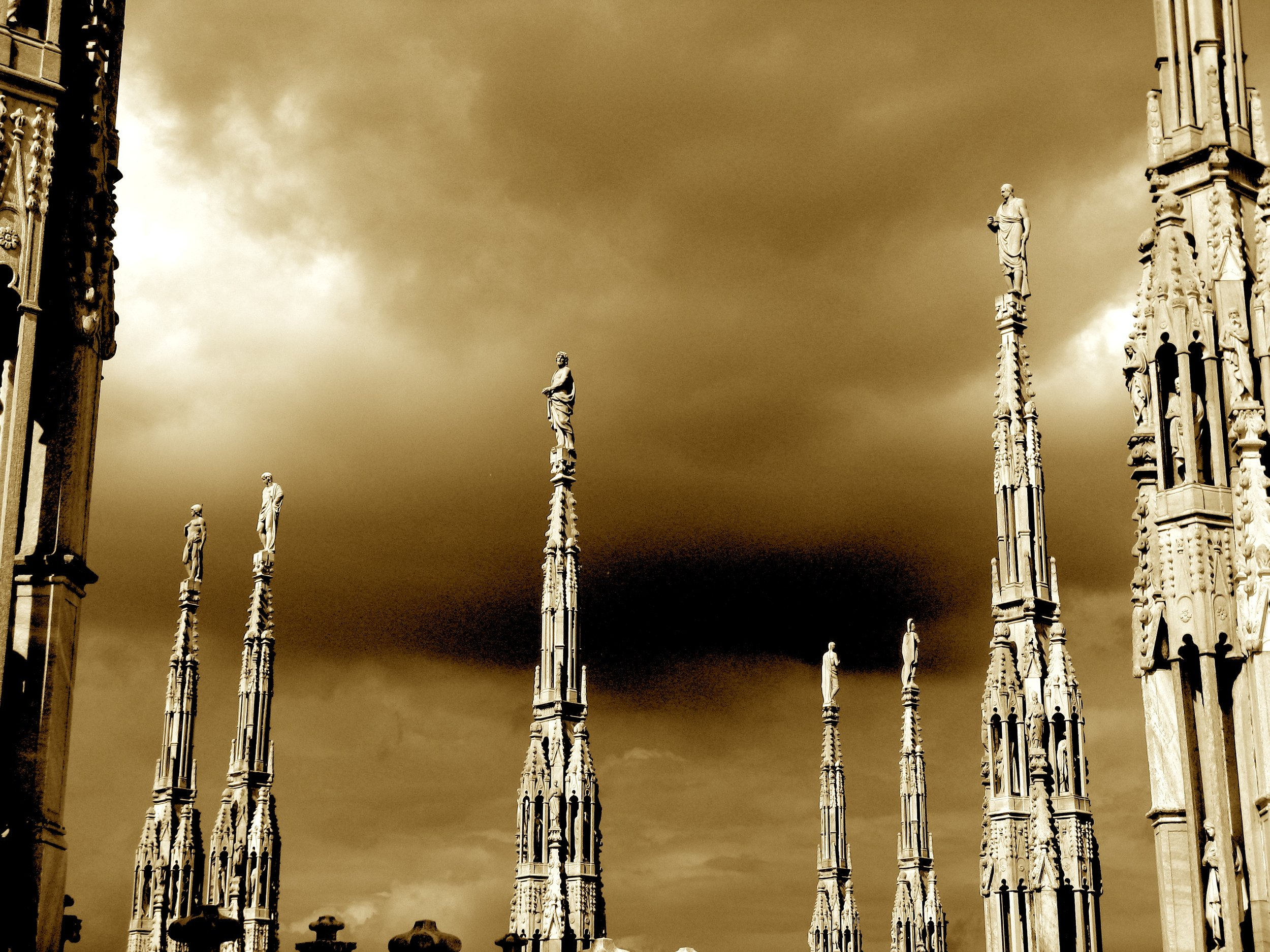 Delicate spires topped with religious figures are part of the elaborately decorated Duomo