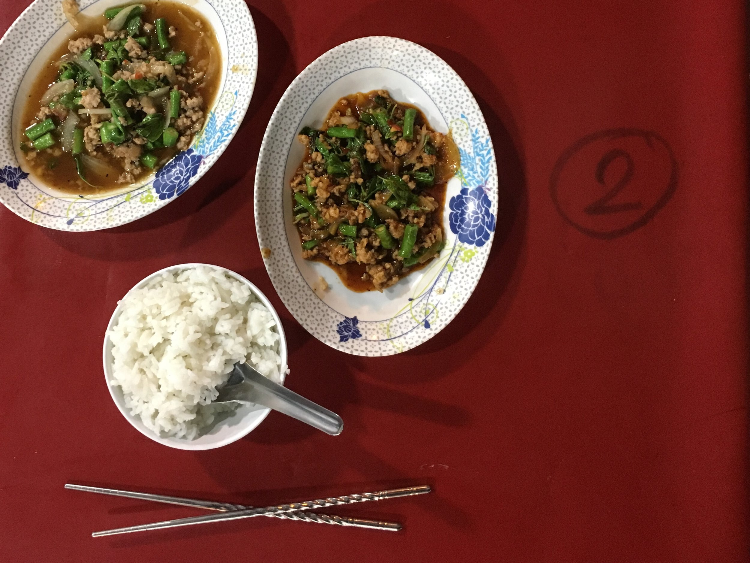 Pad prik gaeng with long beans and rice from a stall along the street in Chiang Mai, Thailand