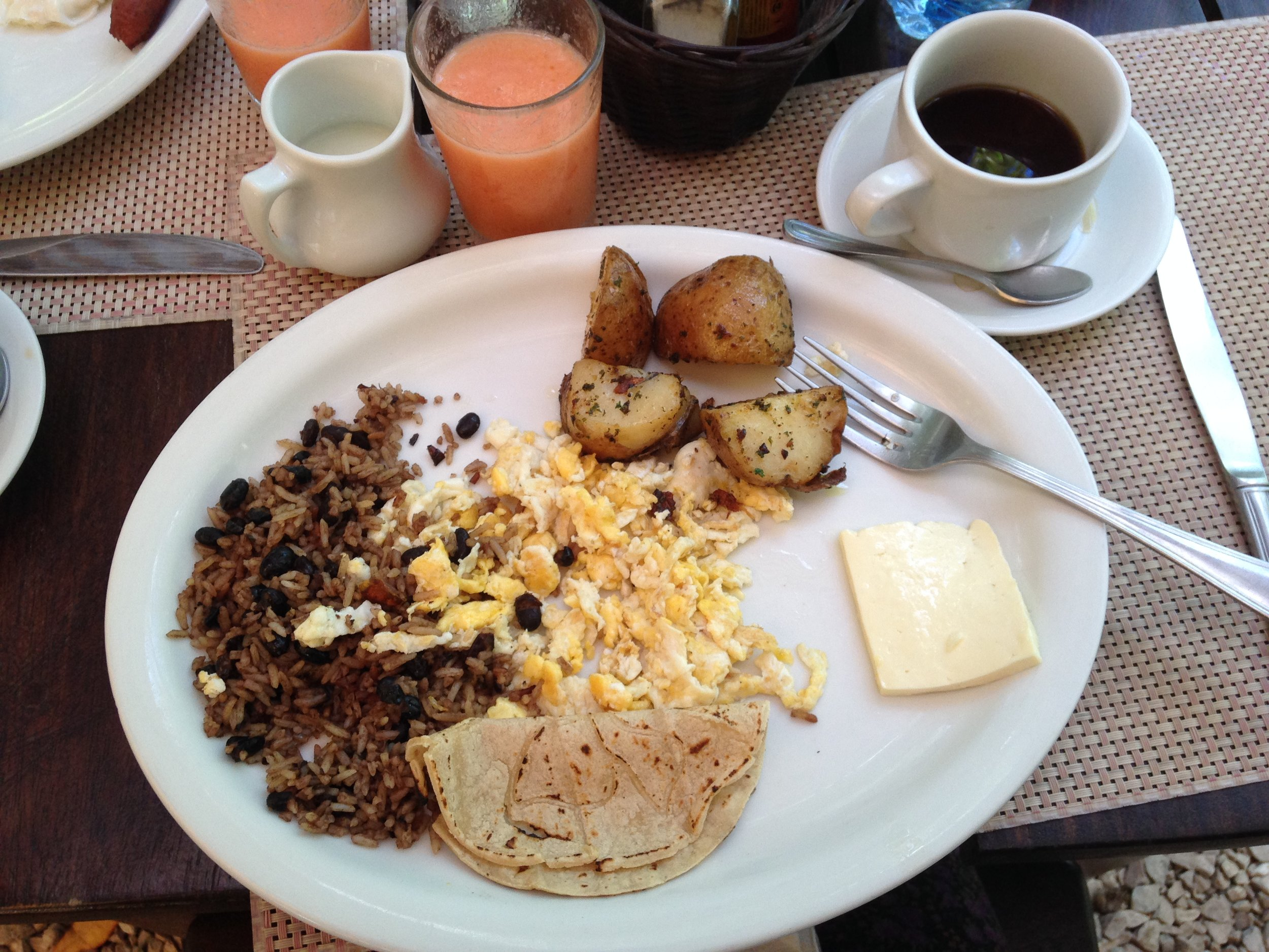 A typical Costa Rican breakfast: gallo pinto with scrambled eggs, fresh tortillas and a couple slices of queso turrialba, a local cheese made in Monteverde that's rindless, unaged and has a high water content. The potatoes are not typical but were included because they were at a hotel
