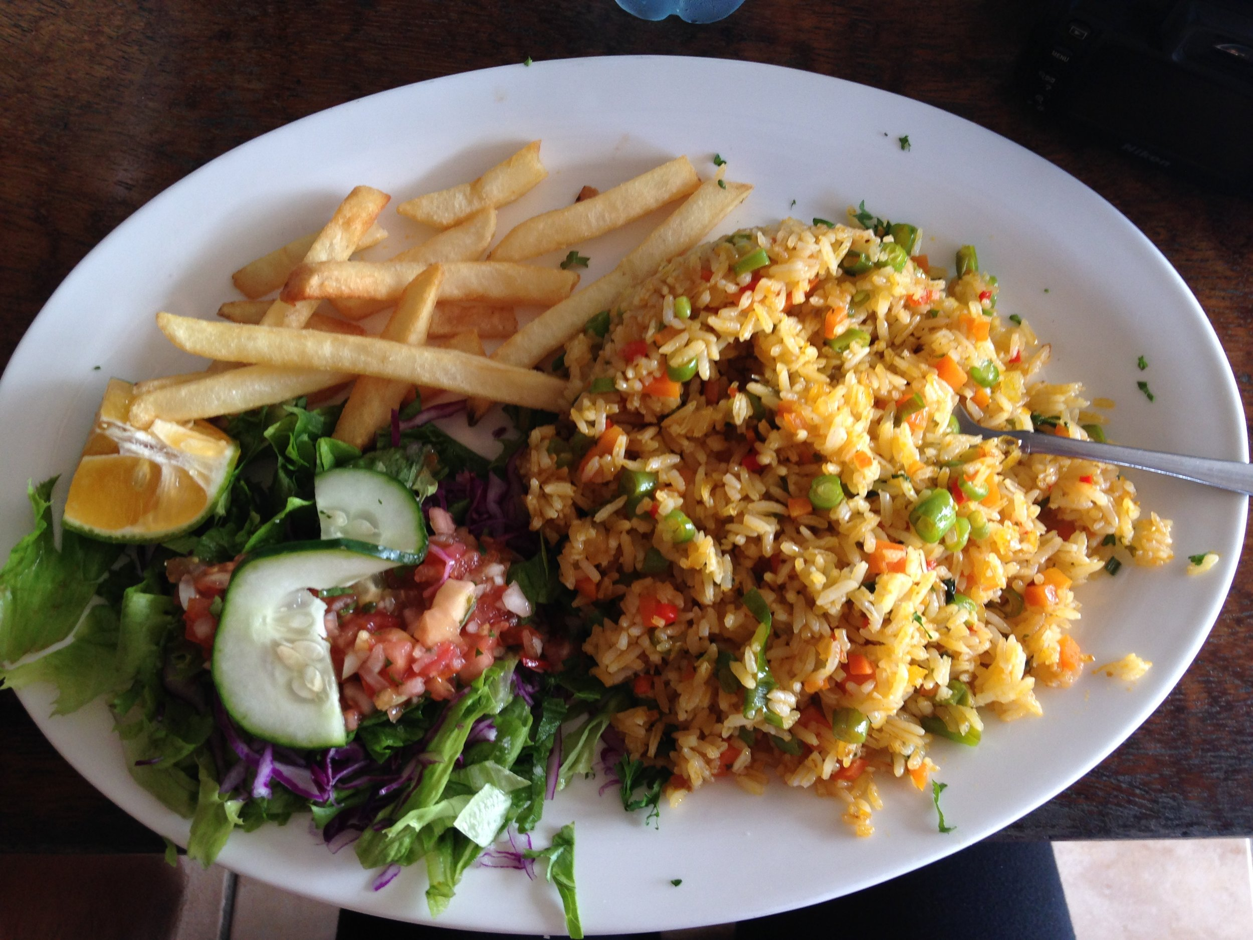Arroz con pollo, exactly how it is served in all Costa Rican restaurants, with french fries and a side salad