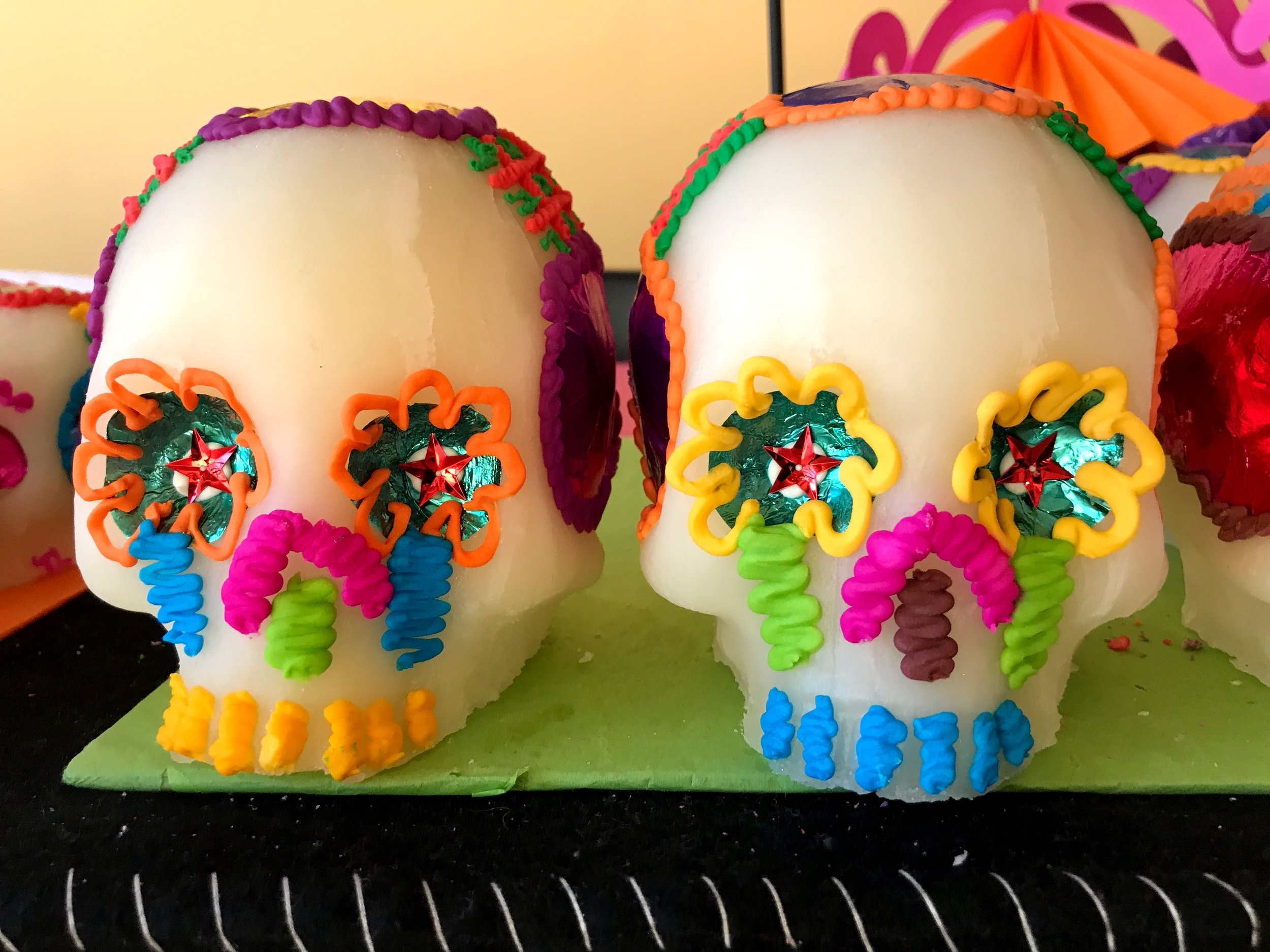 These sugar skulls were crafted by the Mondragón family in Mexico, a specialty they've worked on for generations. The name of the deceased is written on the forehead of the skull