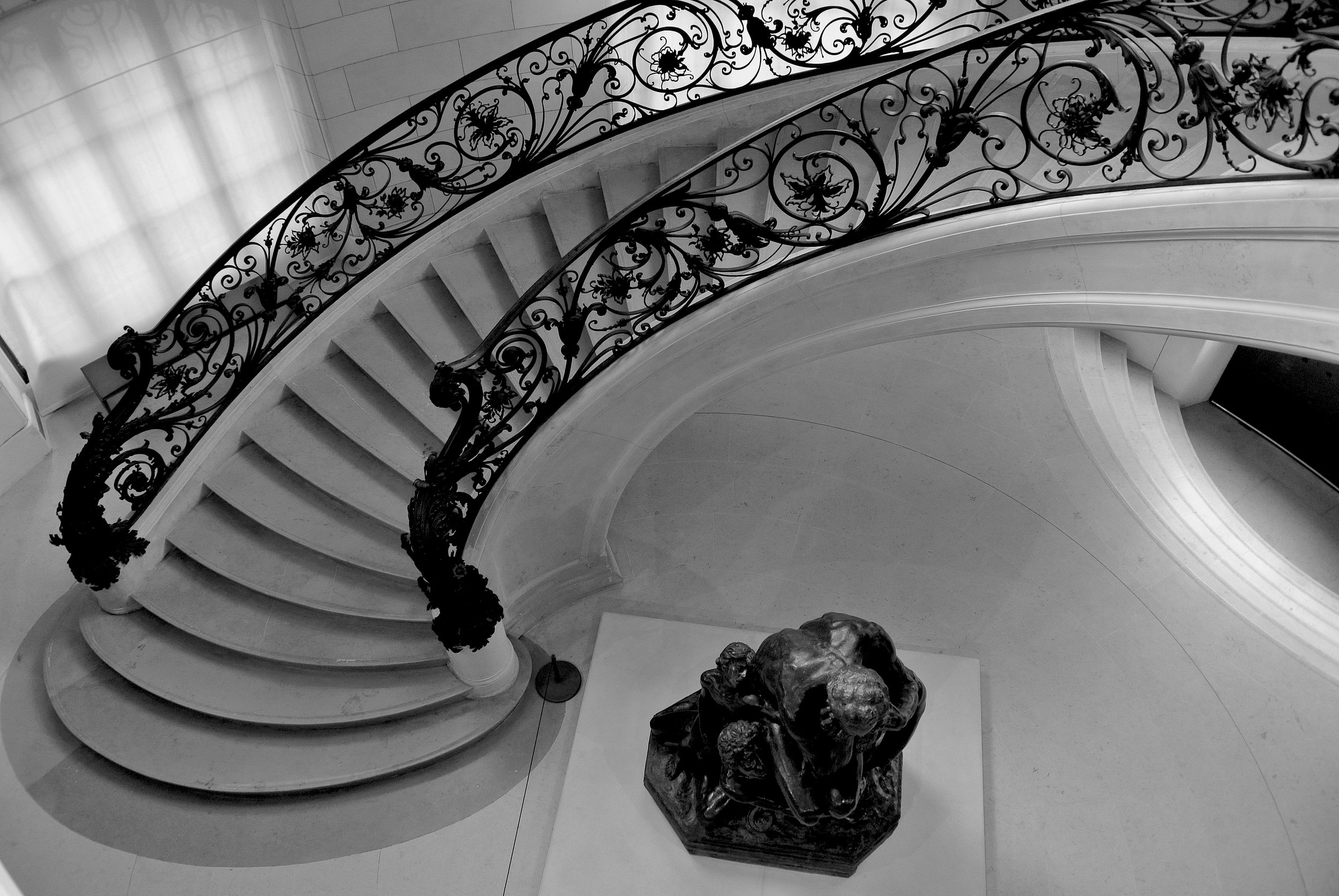 You have to make sure you see Girault's gorgeous lace-like iron staircase