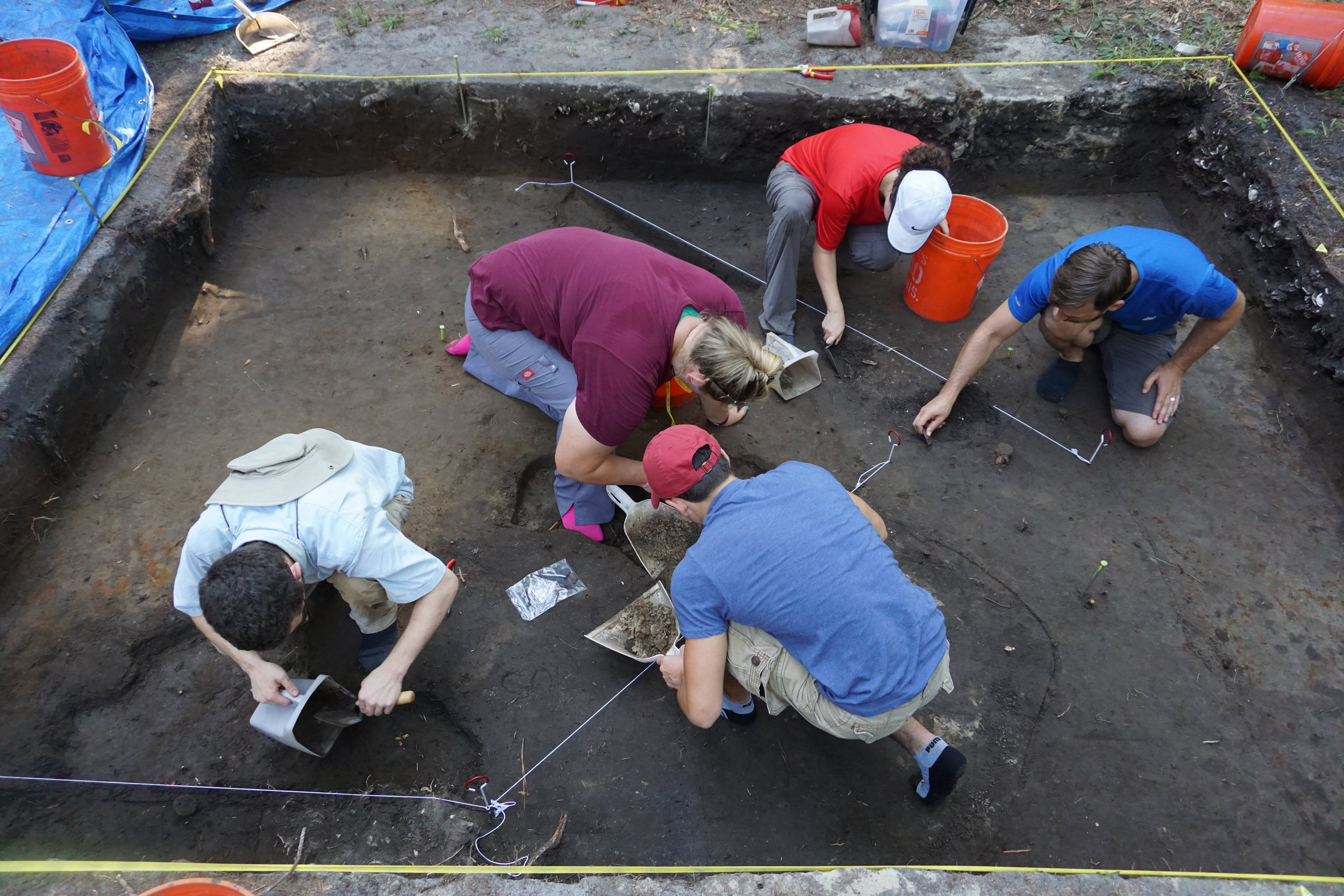 A team of students gets hands-on experience unearthing artifacts at the Sea Pines Shell Ring
