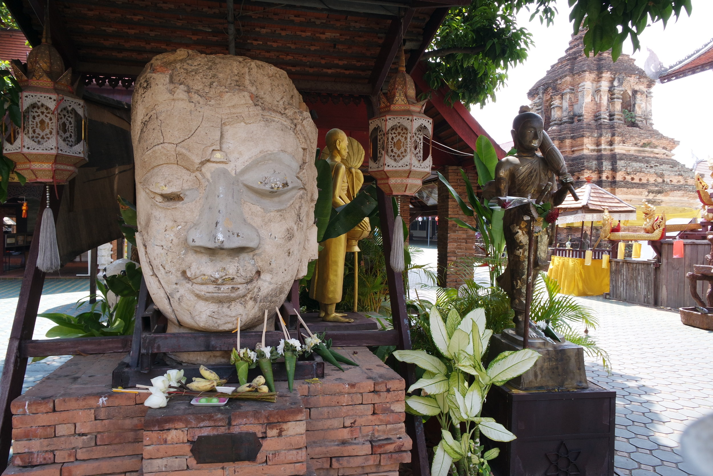 A giant Buddha head greets visitors to Wat Jetlin