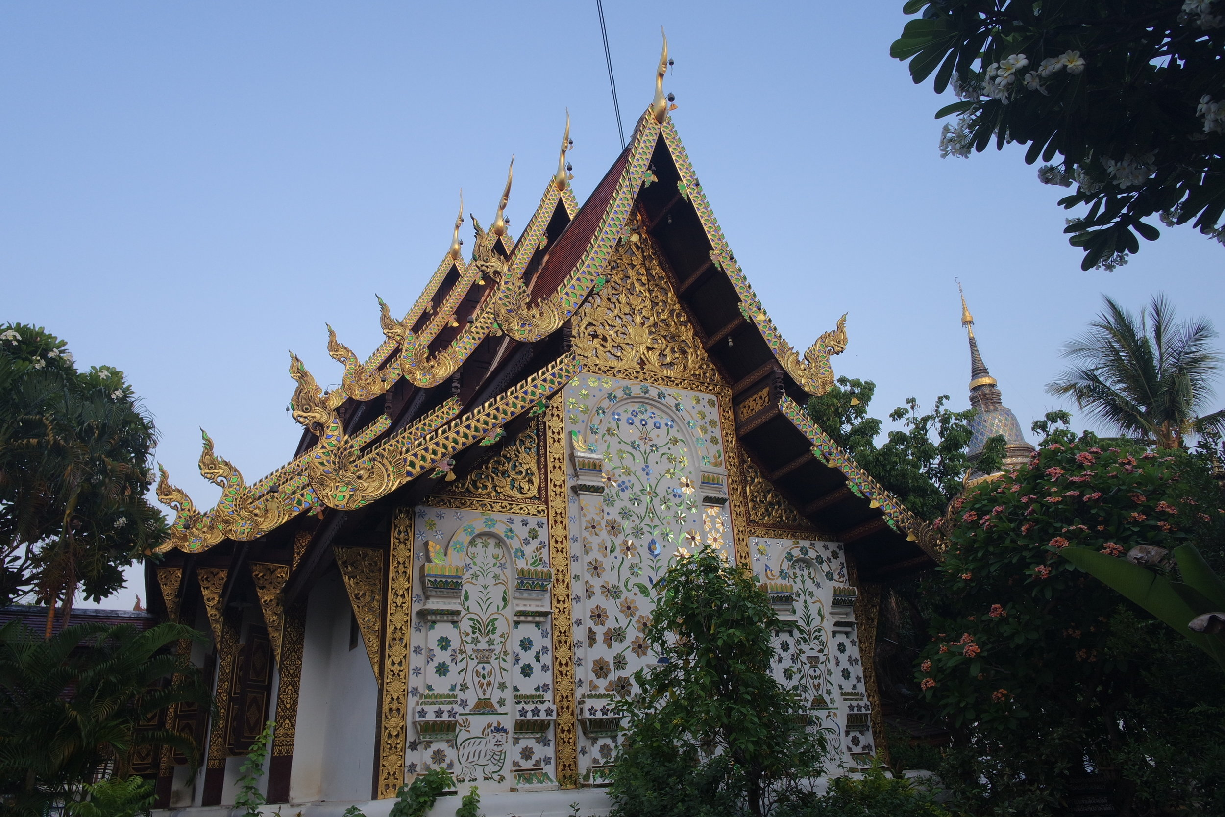 The prettiest part of Wat Ket Karam is the metallic mosaic on the back of the viharn