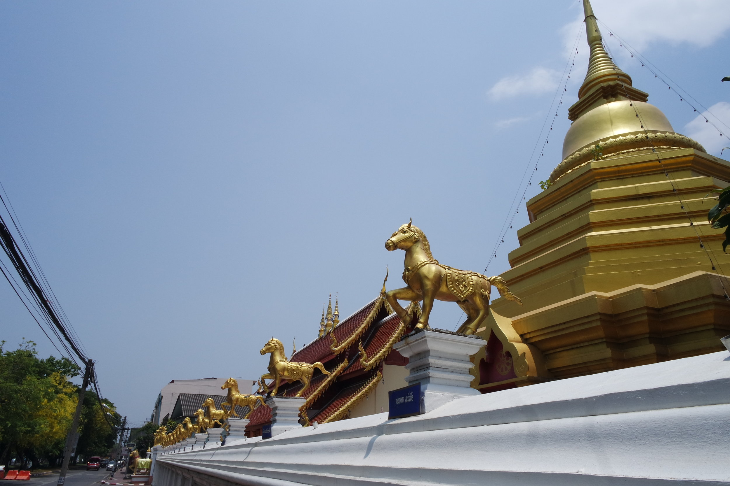 There's not a lot to see at Wat Kuan Kama, aside from the line of horses on the wall enclosure