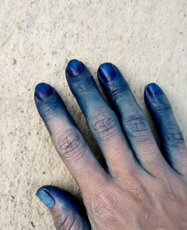 Blue hands are a telltale sign that the person works with indigo (or is the god Krishna)