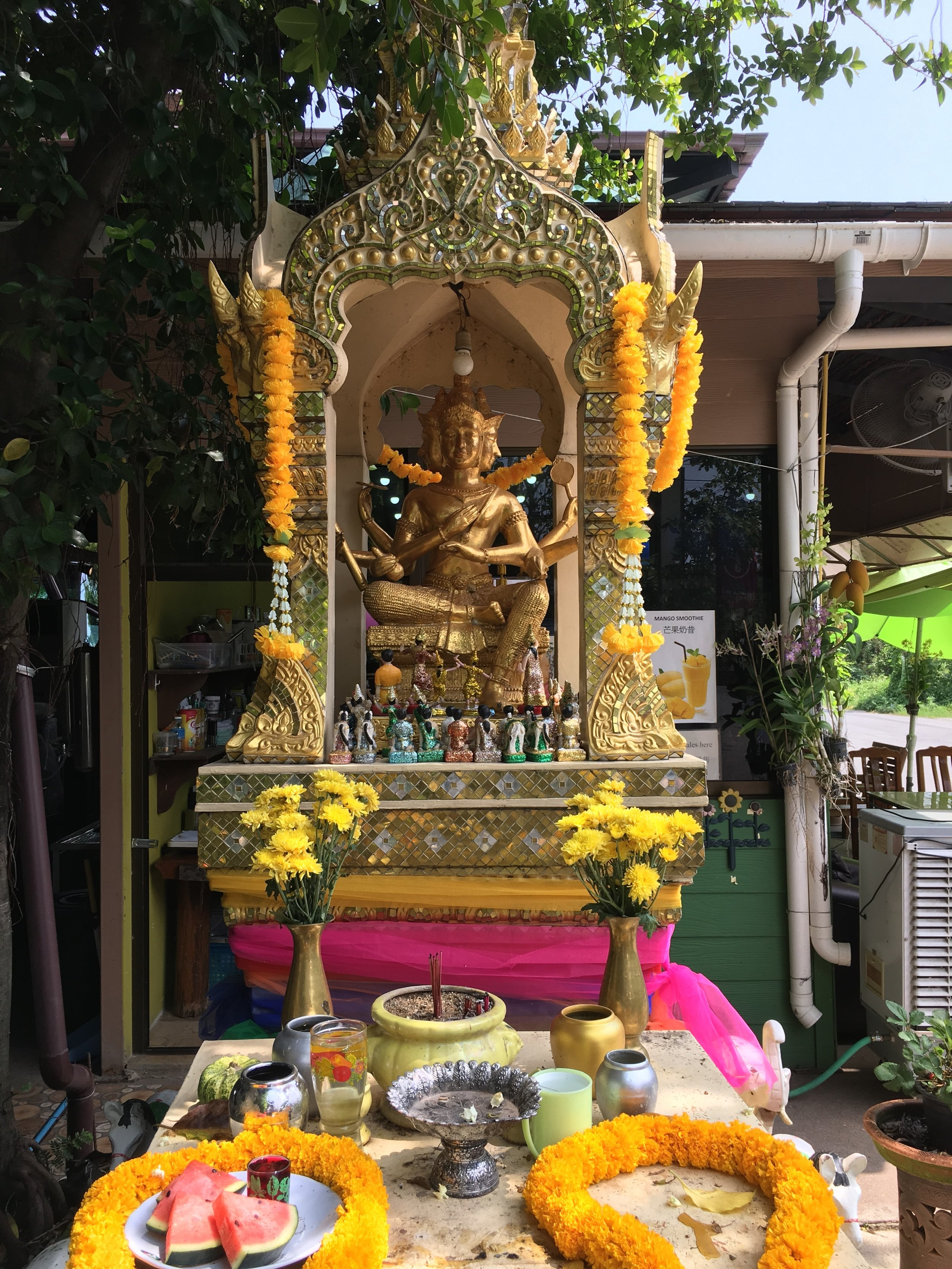 The four-faced Hindu god Brahma is a popular figure in spirit houses, especially in the Bangkok area