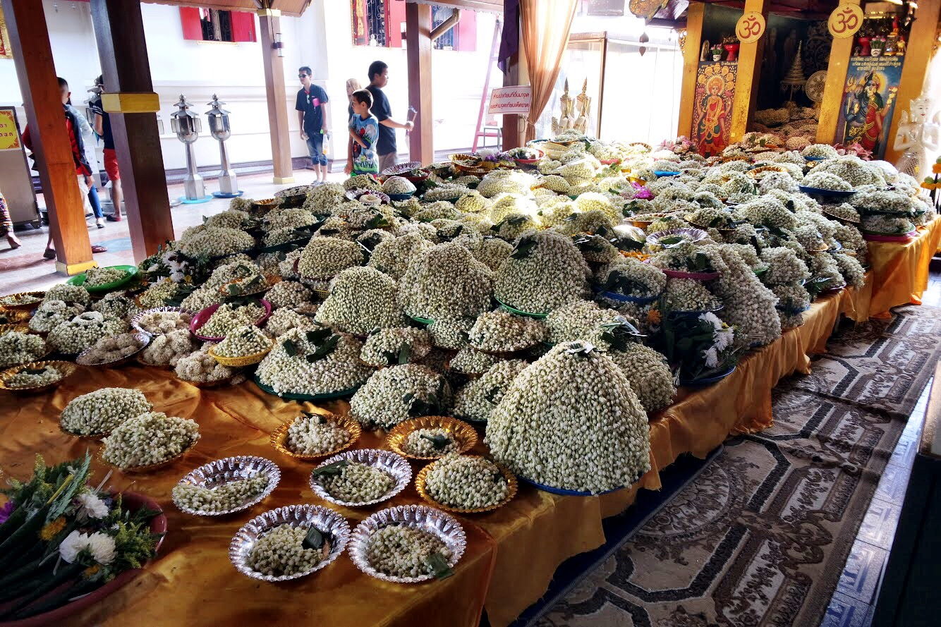Piles of jasmine garlands are offered by those who pray for a wish to come true — and by those whose wish did come true
