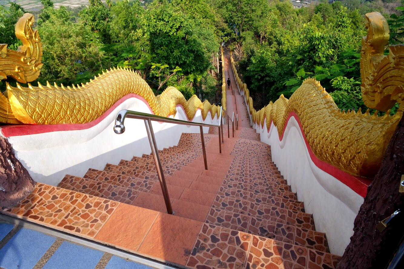 Golden naga undulate up the hill, leading to the panoramic overlook