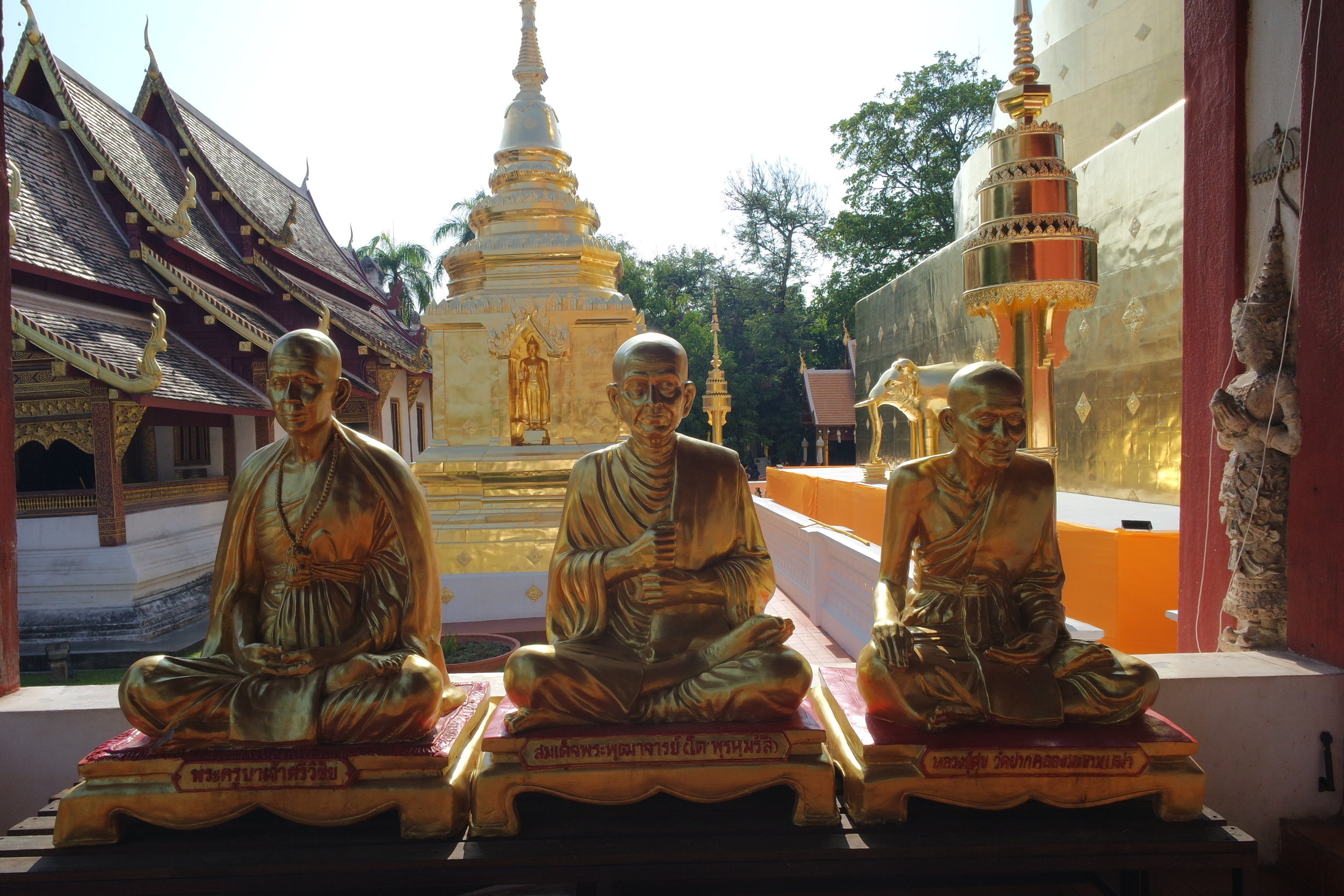 There's no shortage of glittering gold on many Thai temples — and Wat Phra Singh is no exception