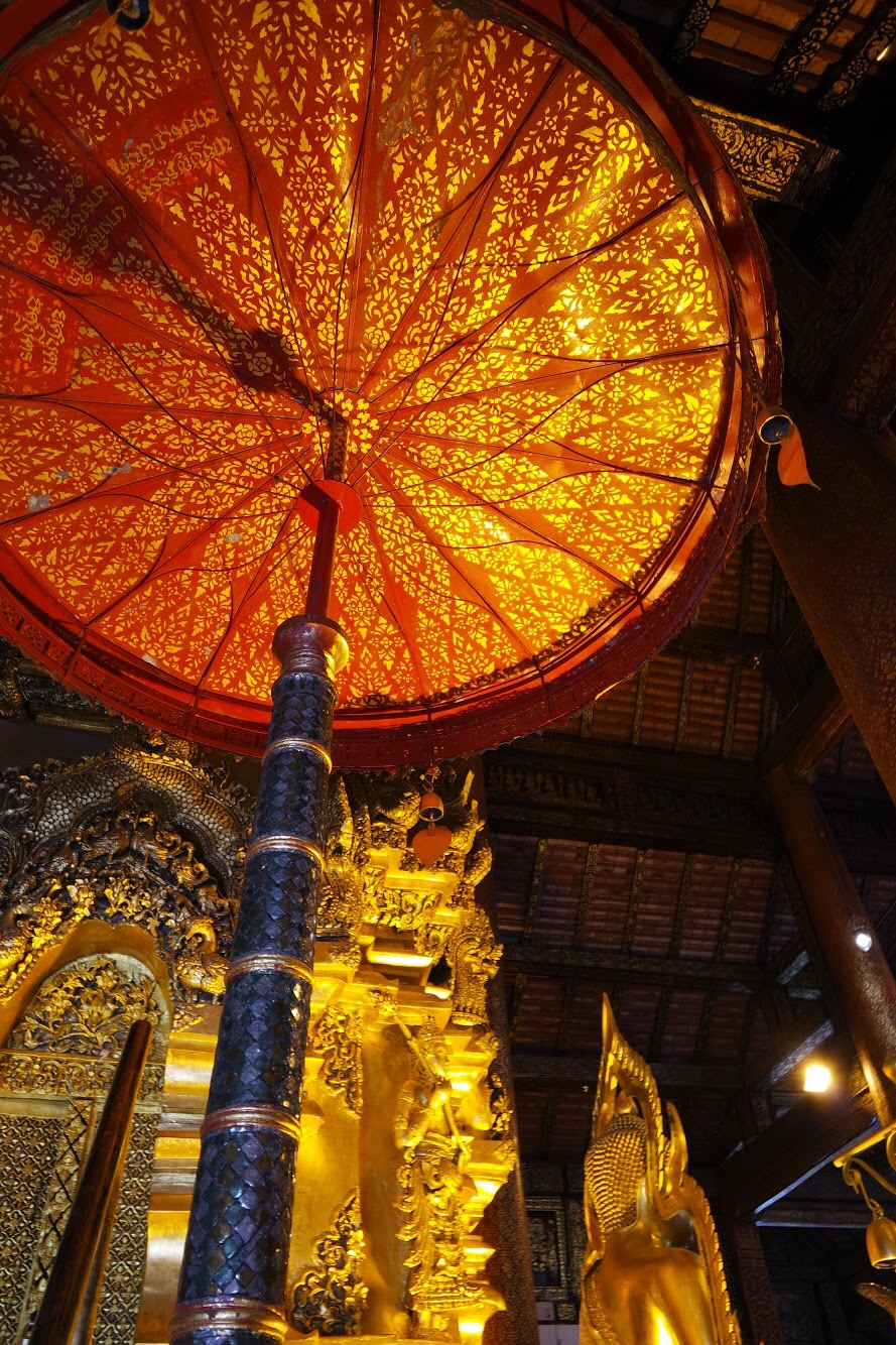 Umbrellas, like the one in the viharn, symbolize enlightenment