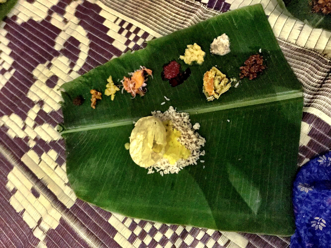 Thali, presented on this banana leaf, consists of small bites of different dishes, much like tapas