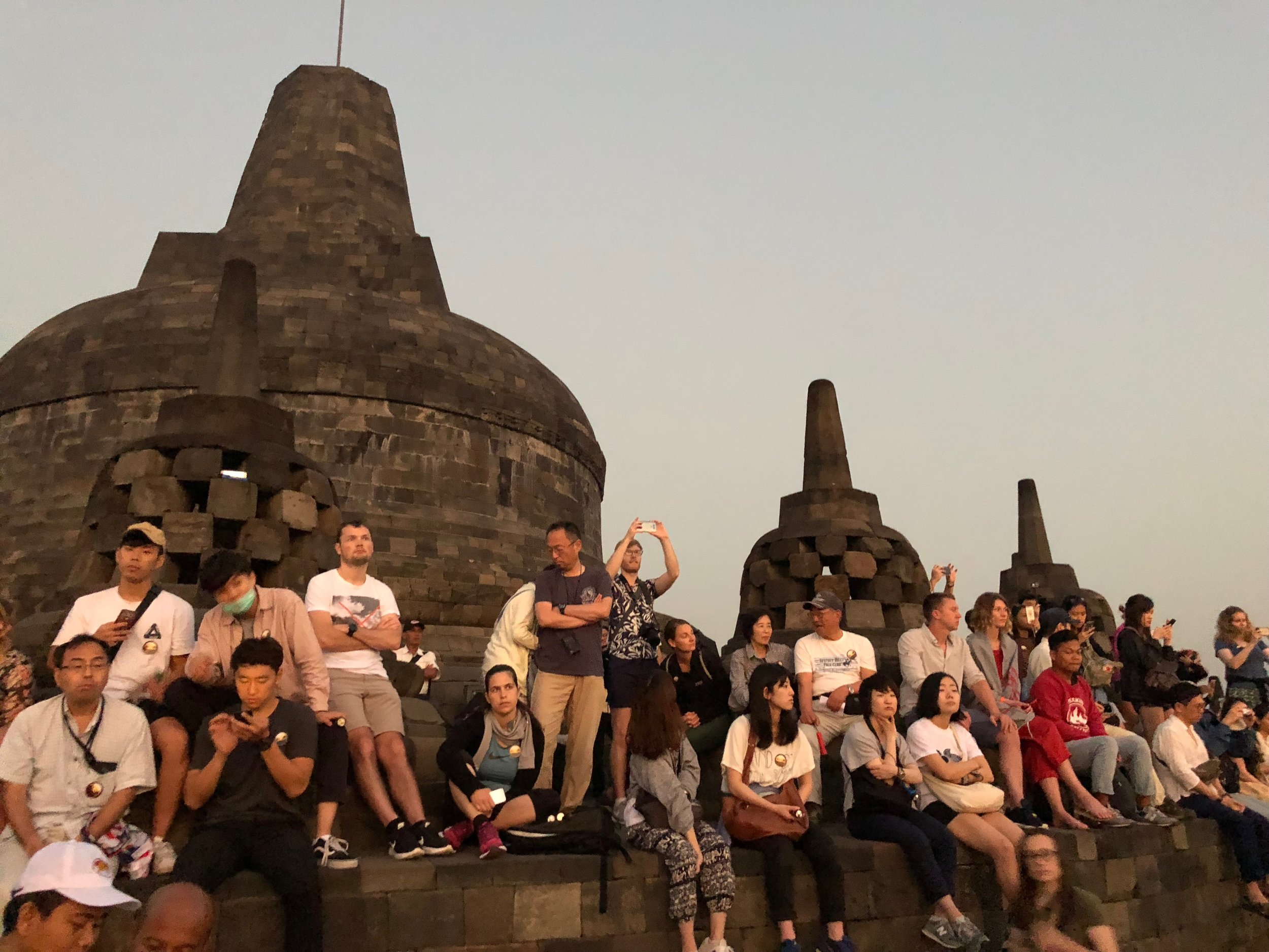 This is the real Borobudur you don't ever see in pictures — the hundreds of tourists all vying for a prime spot to photograph sunrise