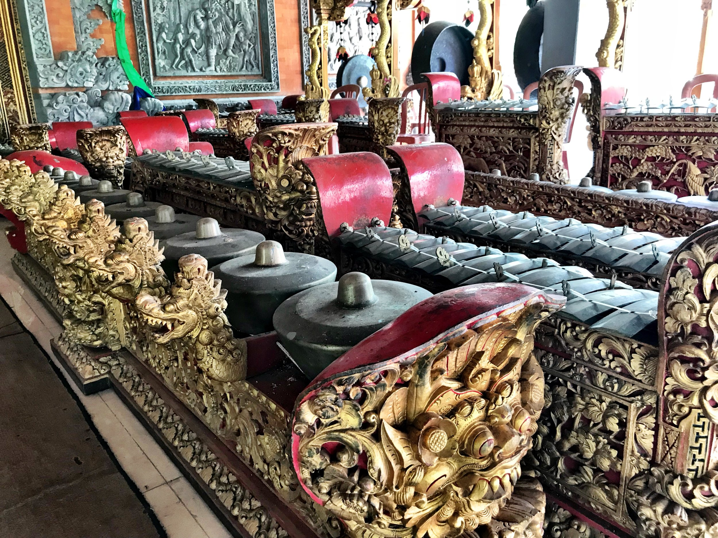 The instruments are intricately carved with creatures from Balinese mythology