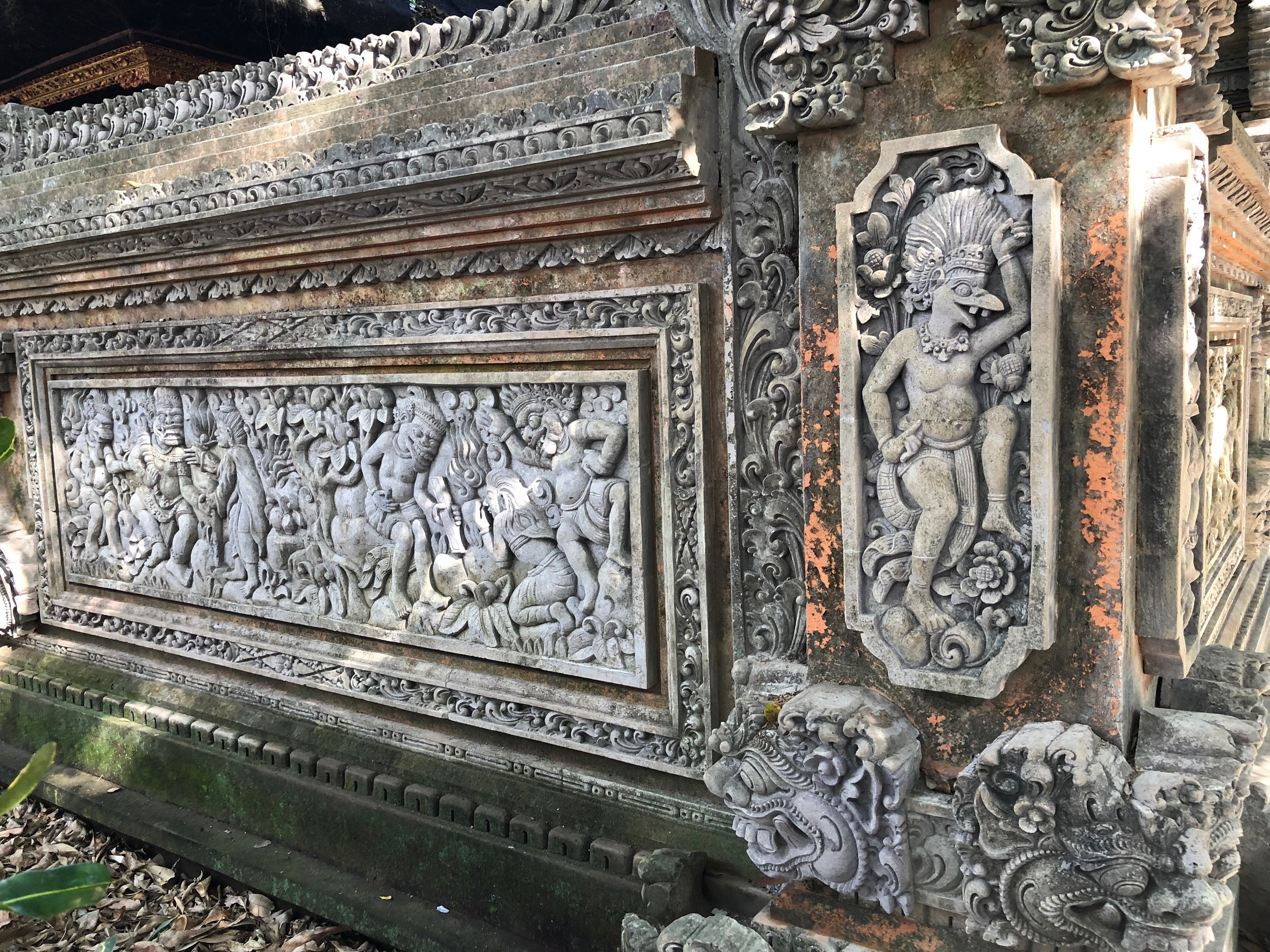 You can skirt around the exterior of the pura dalem and admire the bas reliefs