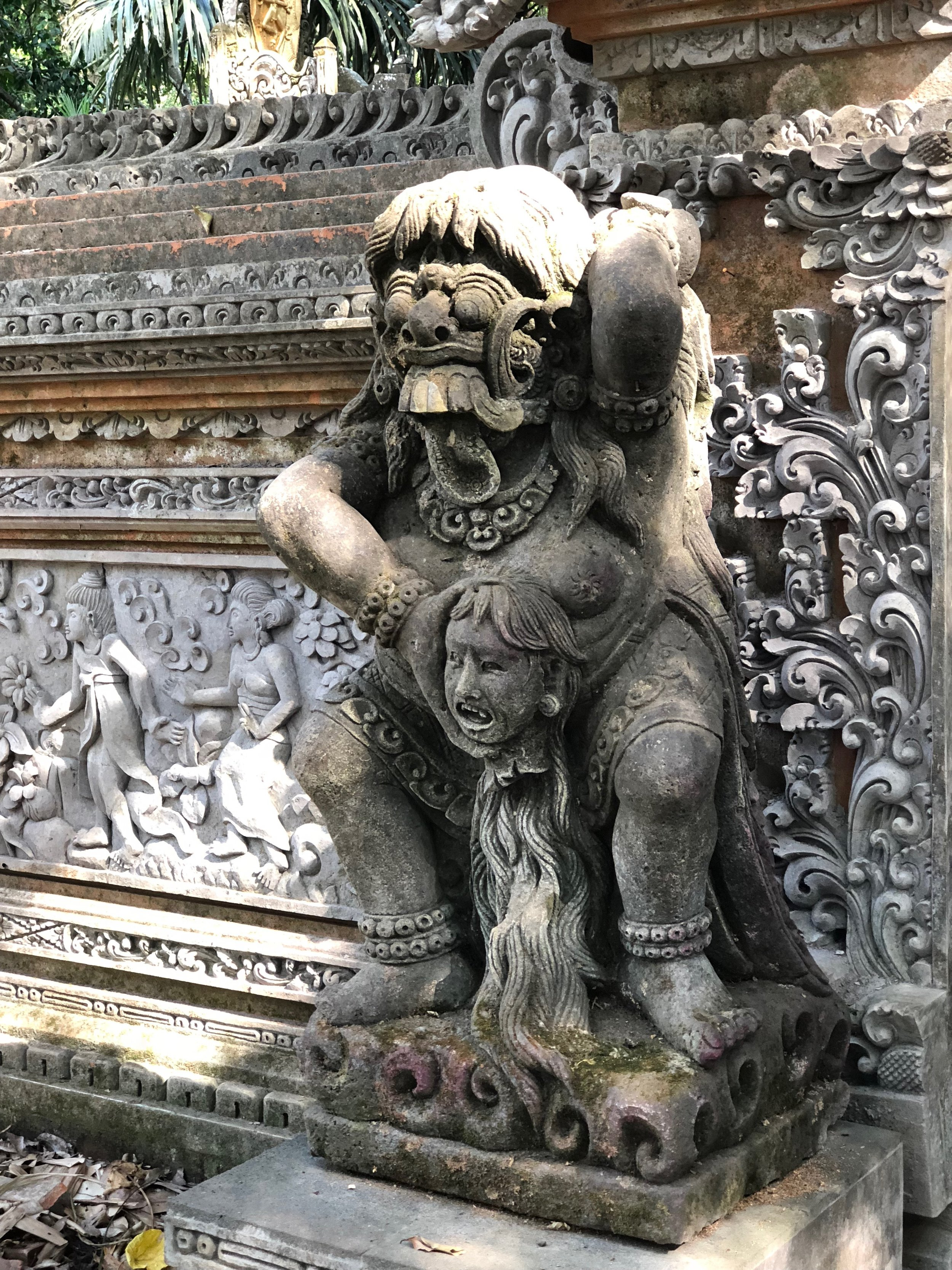 Statues of demons surround the temple of death
