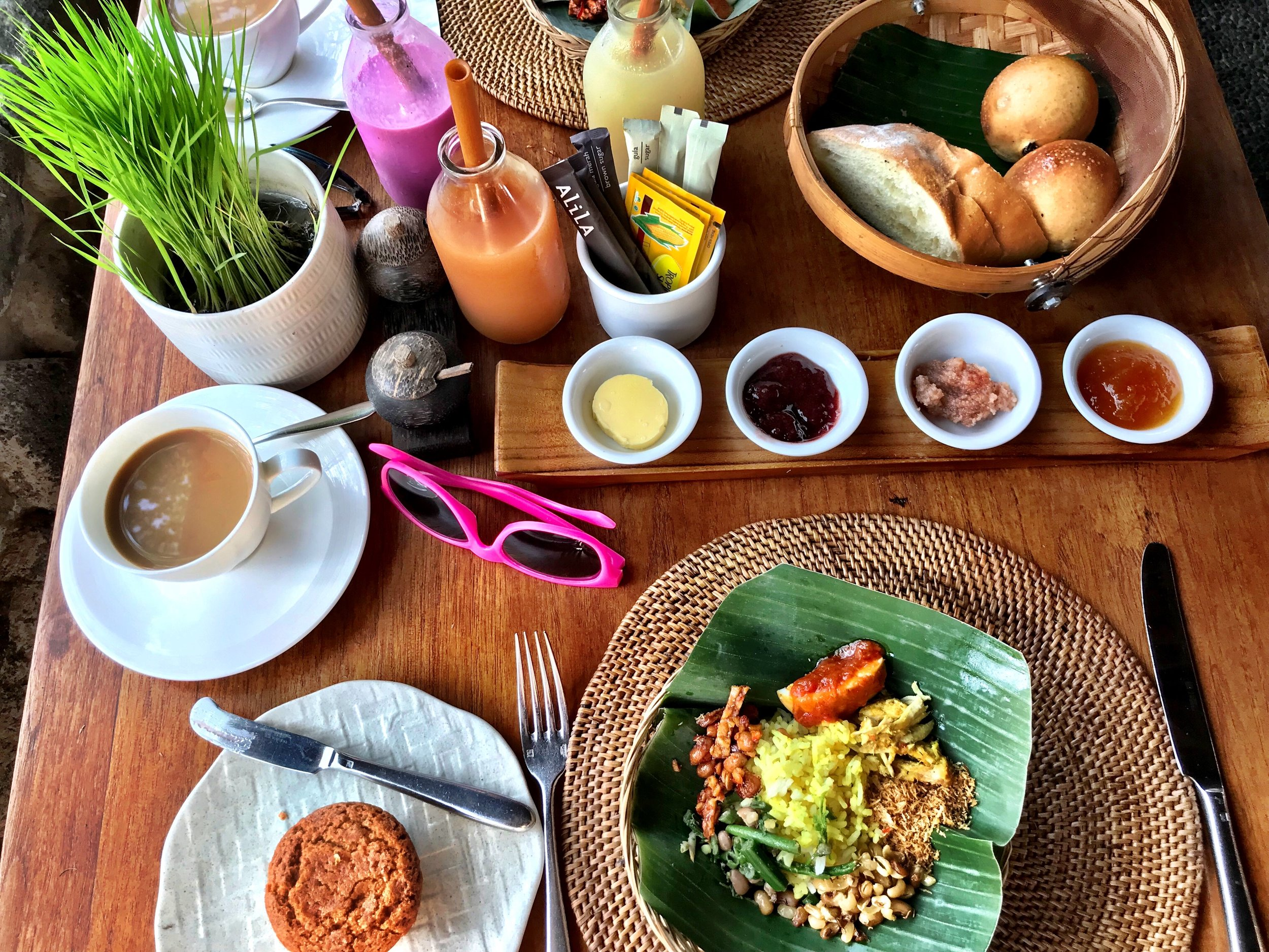 A typical breakfast at Alila: fresh baked goods, a trio of smoothies, coffee and nasi goreng (pink sunglasses Wally's)