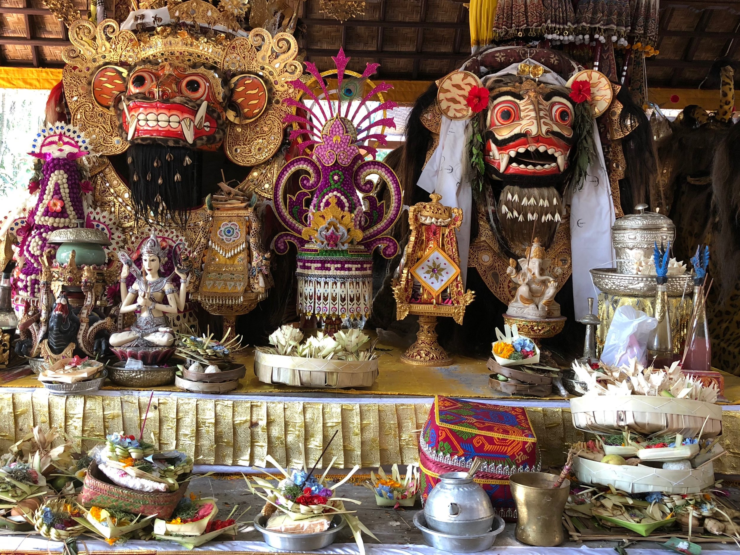 Masks of Barong lined an entire pavilion at Samuan Tiga