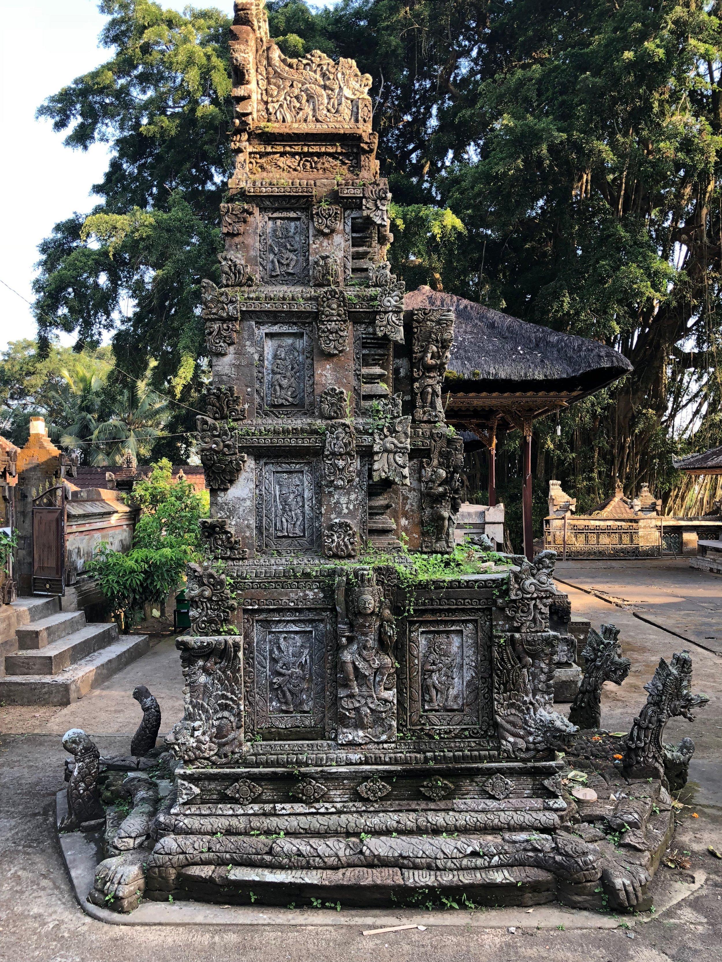 This intricately carved padmasana shrine, or lotus throne, is dedicated to the Hindu trinity of Brahma, Vishnu and Shiva