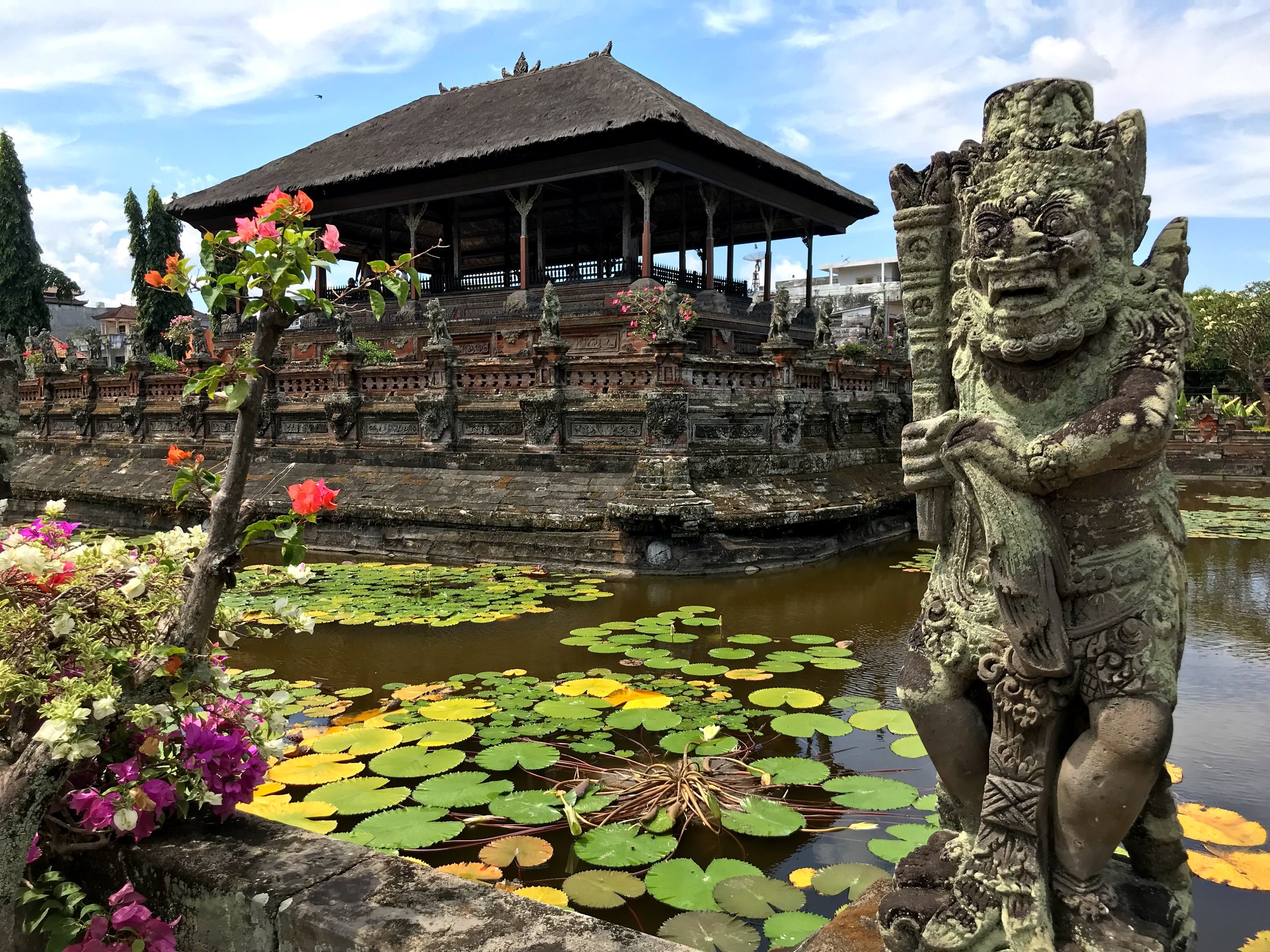 Monstrous statues, lily-covered pools of water and pavilions filled with comic book-like artwork come together at Klungkung