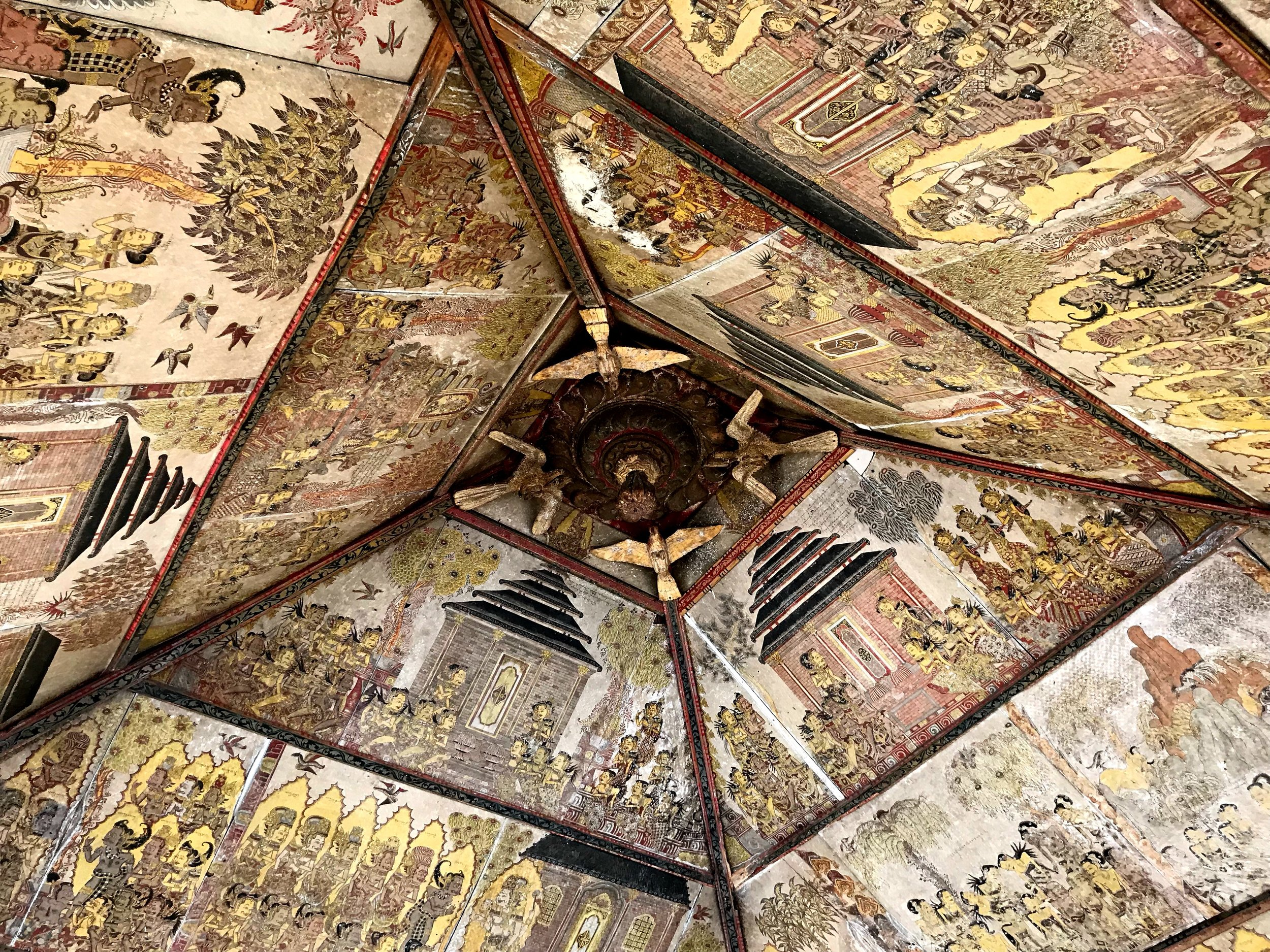 The ceiling is covered with illustrations — it's like a Balinese comic book about a trip to Hell