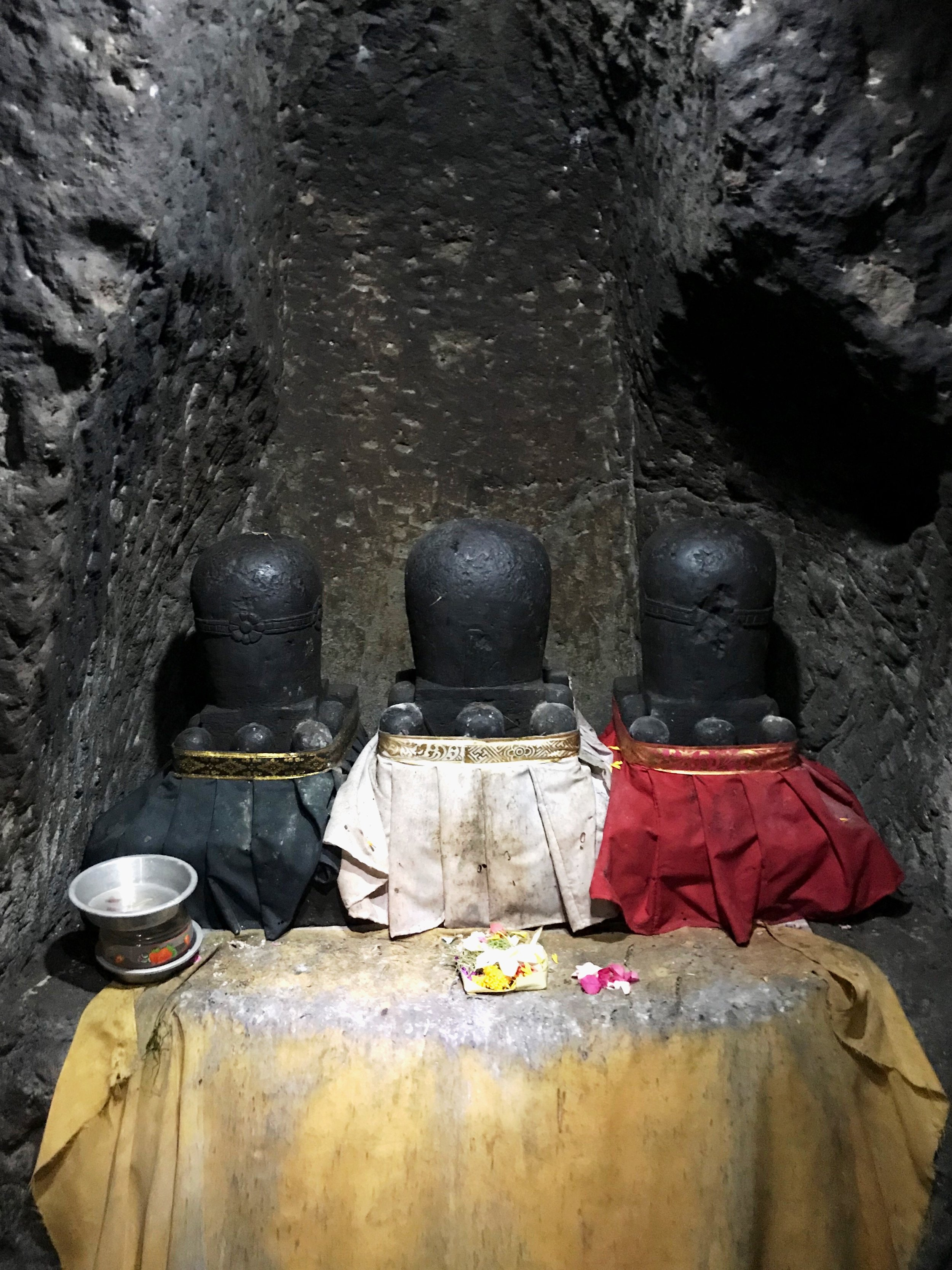 Inside the cave are three phallic linga in honor of the Hindu deity Shiva the Destroyer