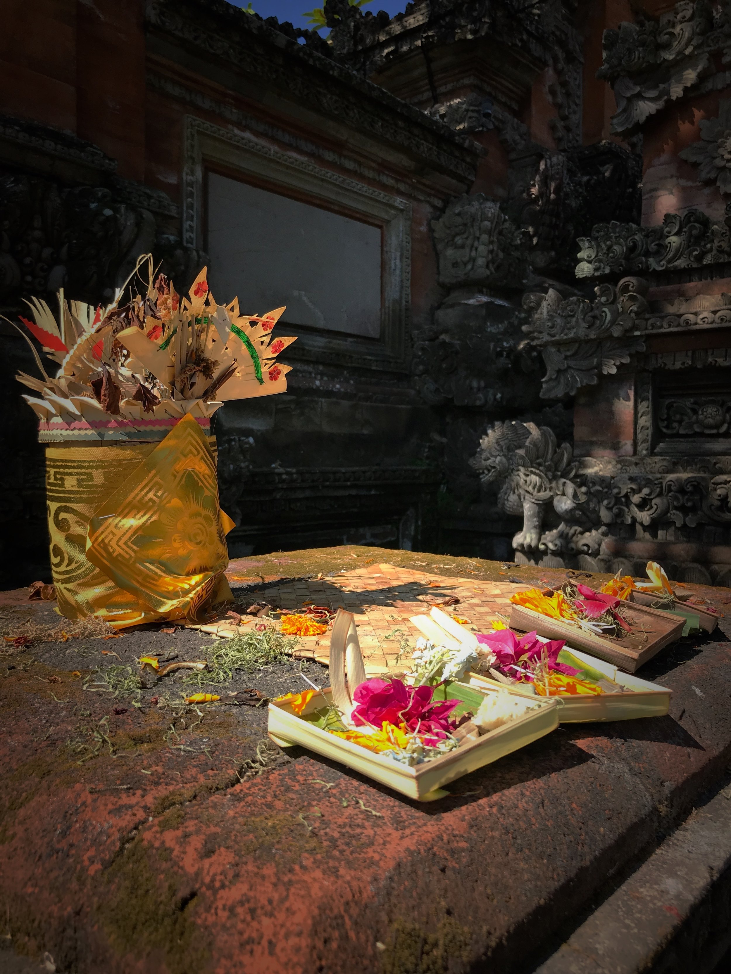 People leave offerings of flowers for Saraswati