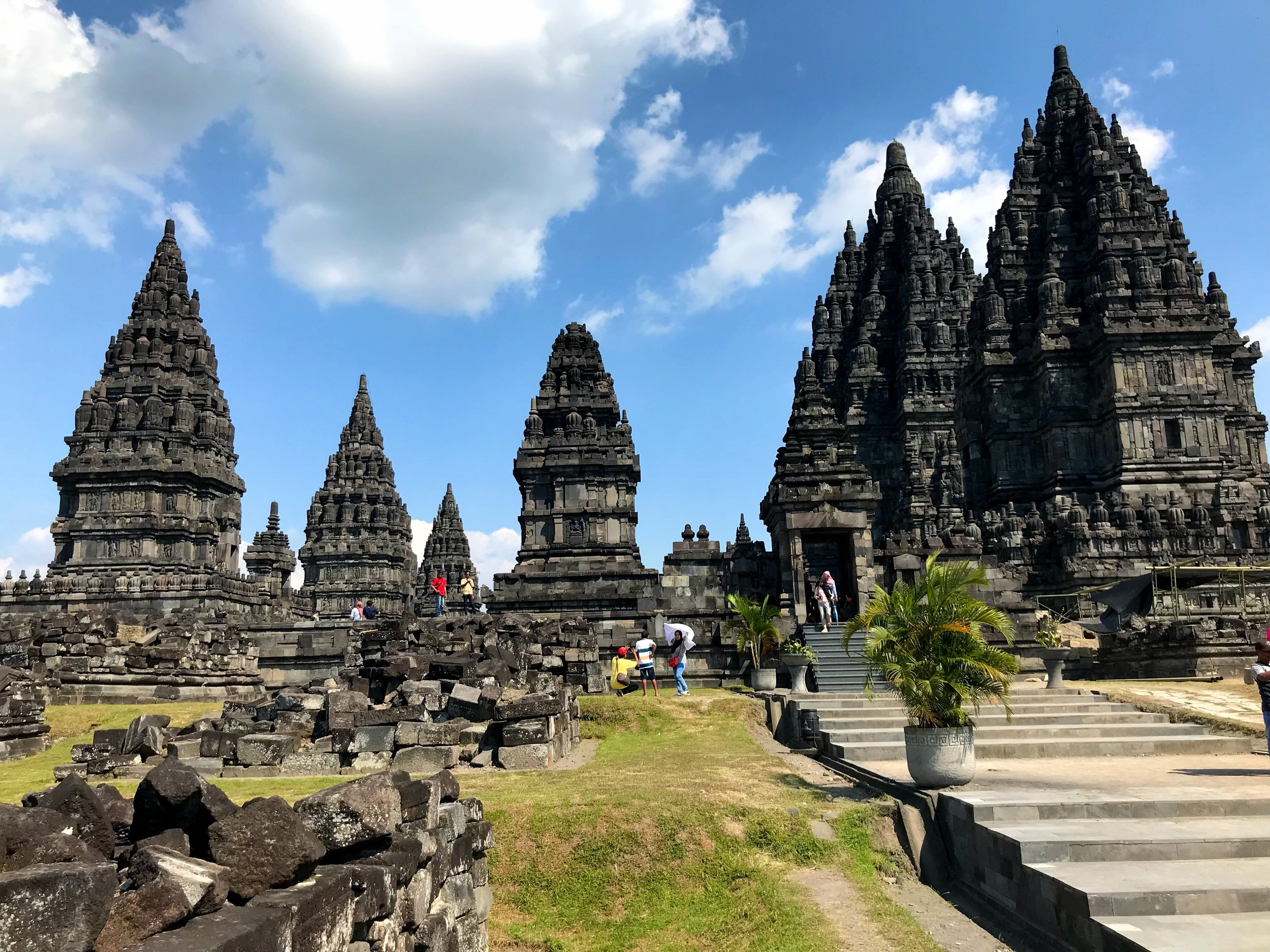 The ornate black stone temples create an imposing silhouette
