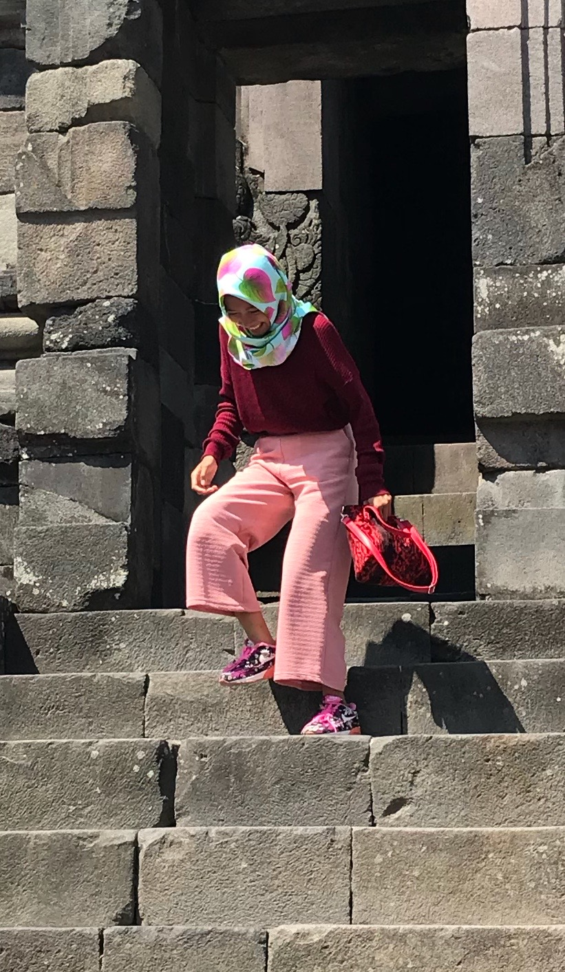 Pretty in pink: An Indonesian woman enjoys her visit