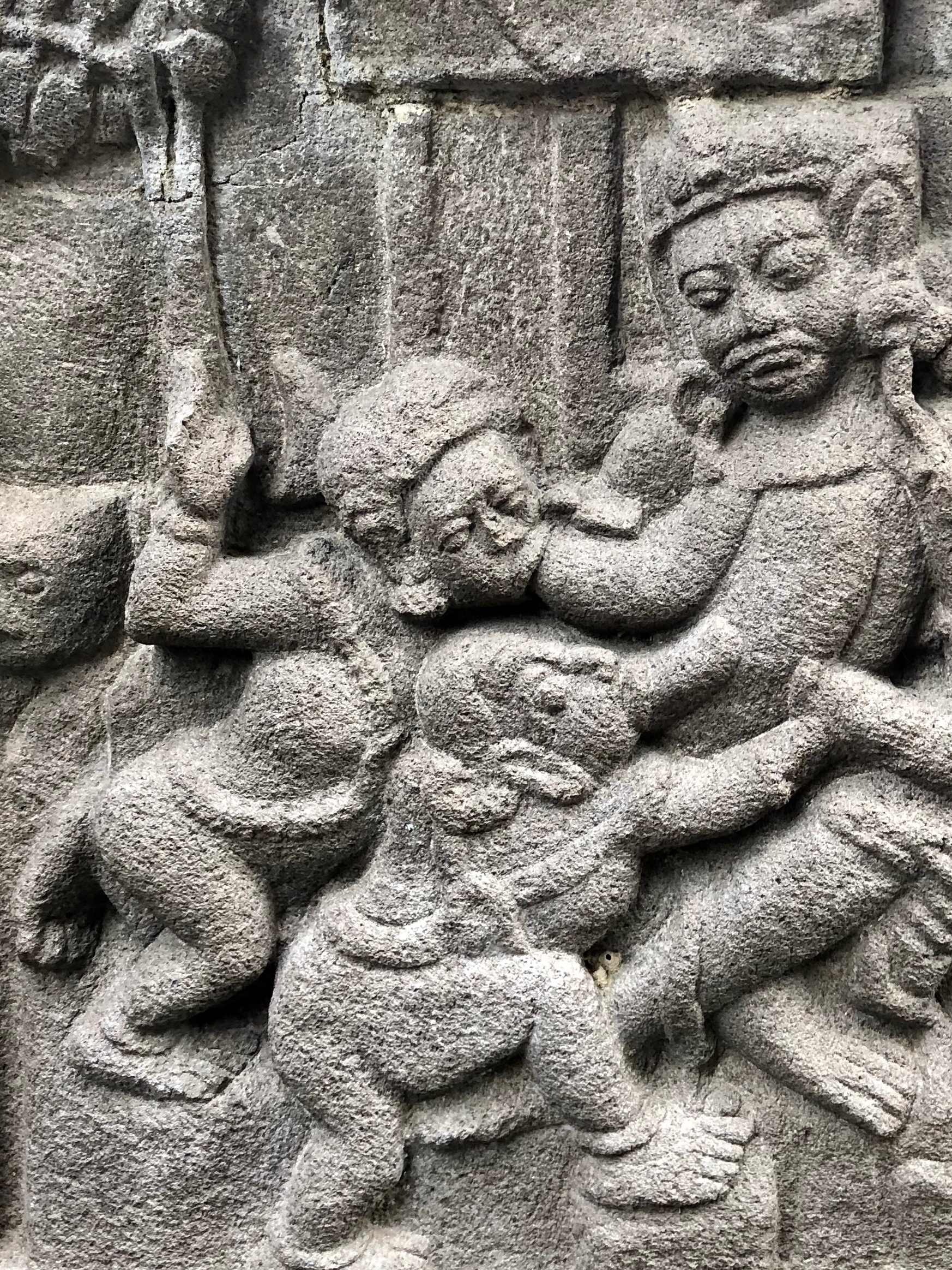 Are they breastfeeding? Some of the carvings on Hindu temples can be quite bizarre