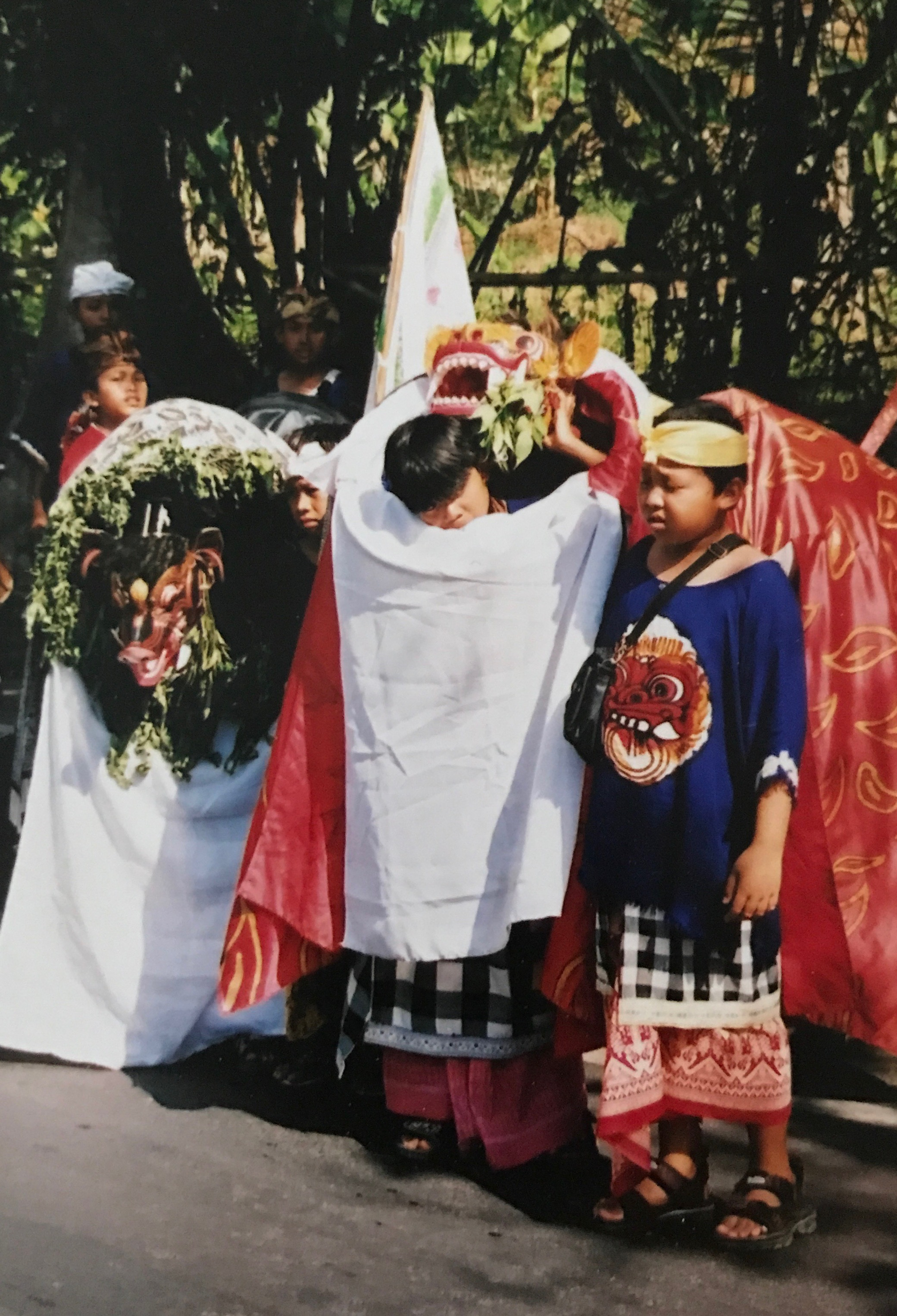 During the Galungan festivities, boys don the Barong mask and parade through town, looking for sweets