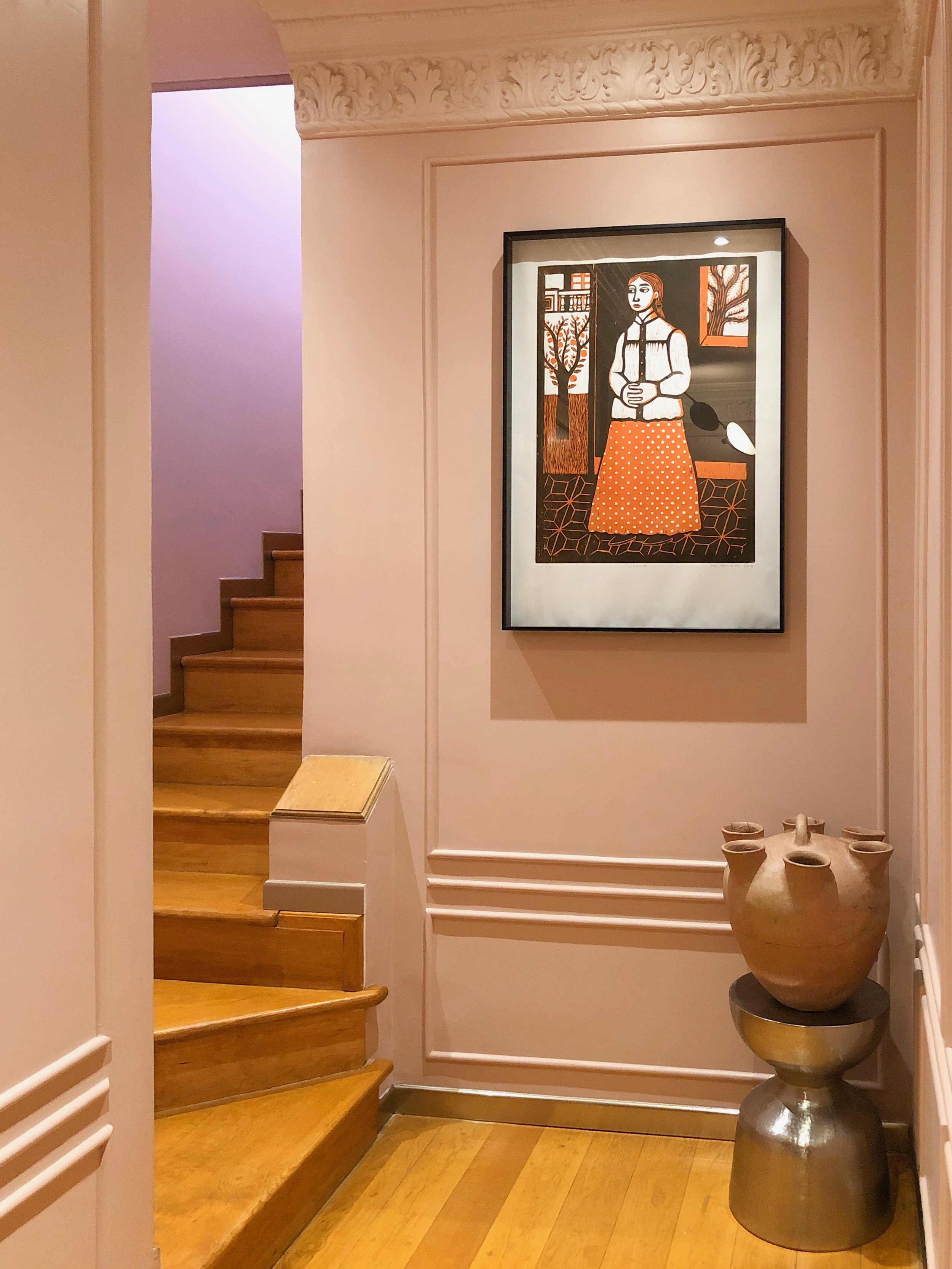 This woodcut, off the check-in area, shows the beloved housekeeper-cook-nanny Ignacia as a young woman