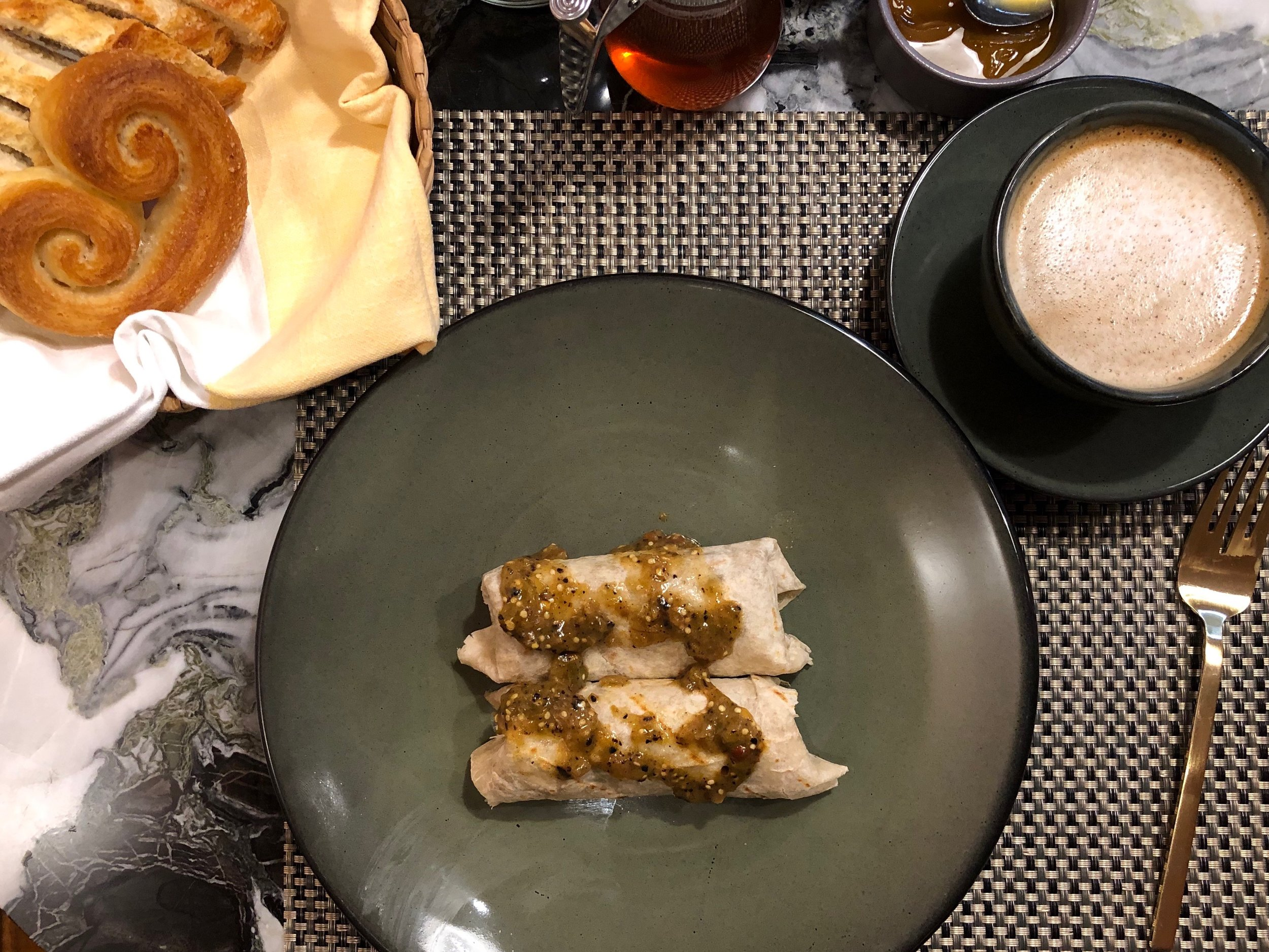 """The curlicue pastries they call orejas, or """"ears,"""" a main dish (this one with cecina, rehydrated salted dried beef) and coffee"""