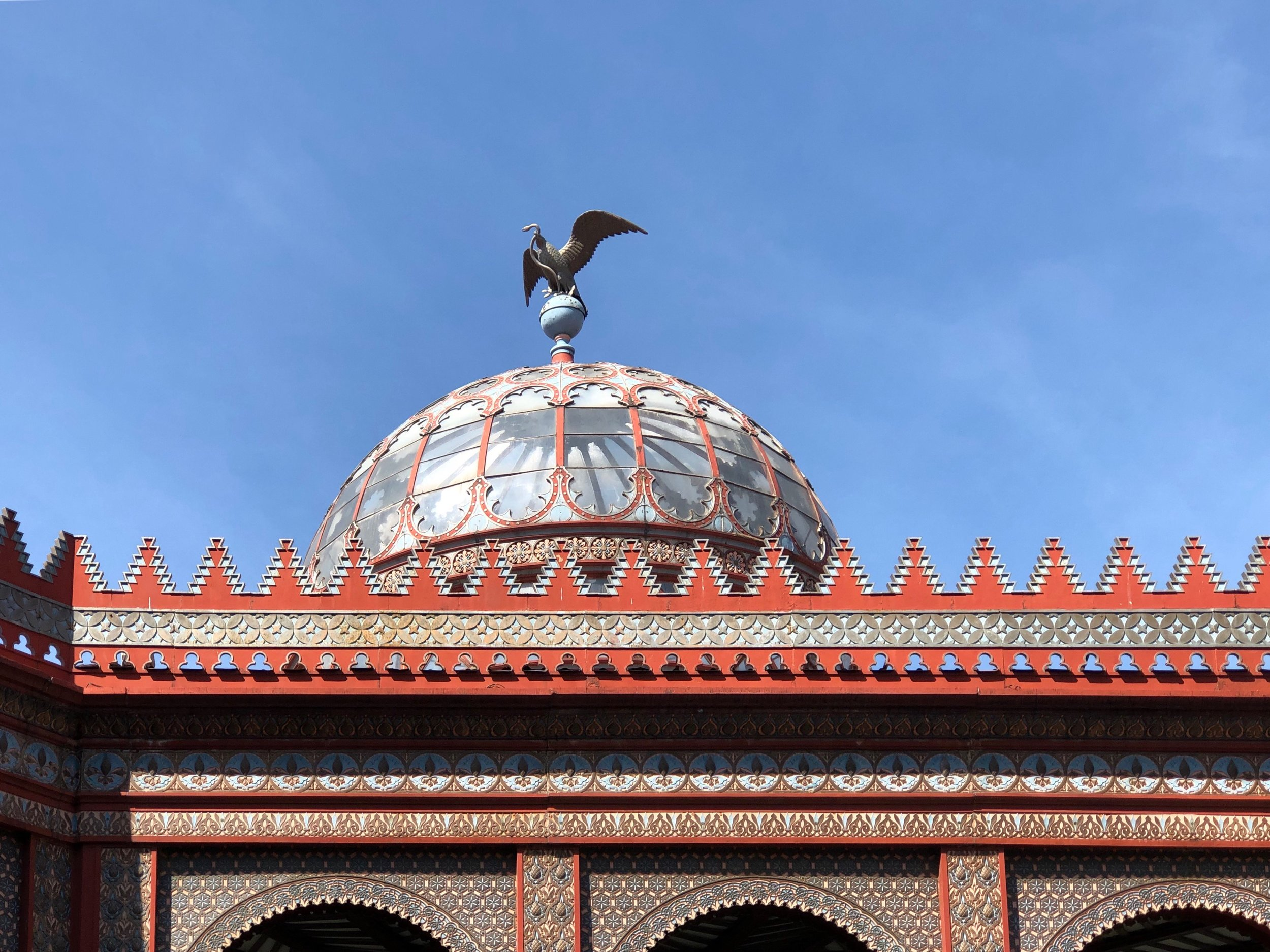 Atop the dome, an eagle attacks a snake — Mexico's national symbol