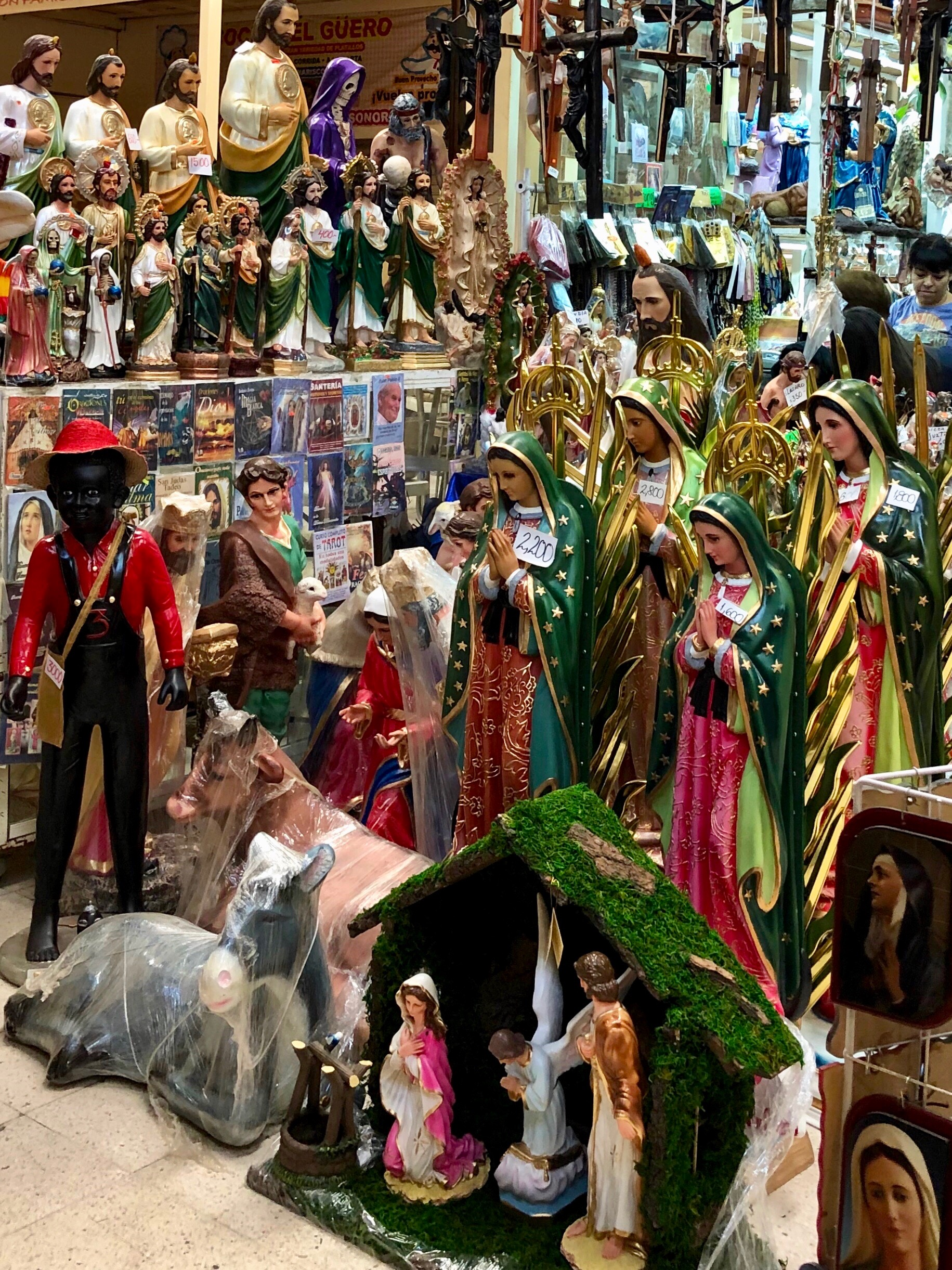 Stalls filled with Catholic icons are side by side with ones selling Santería and brujeria totems