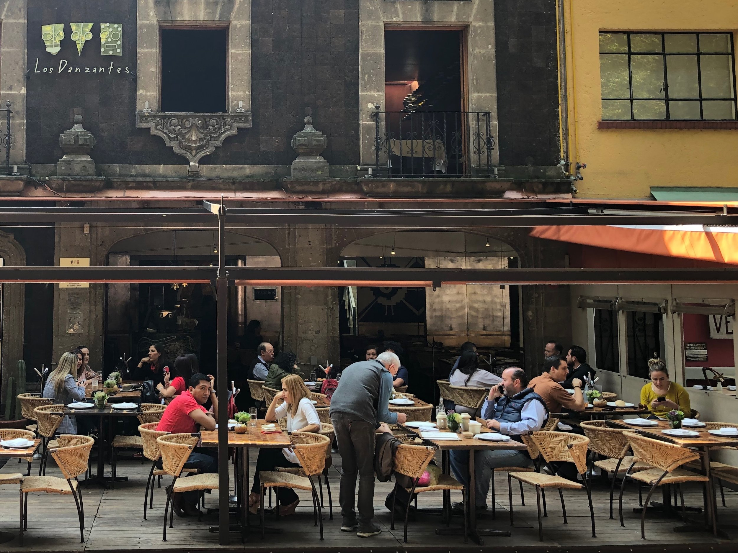 Grab a bite on the patio of Los Danzantes, just off the park, for good food and people-watching