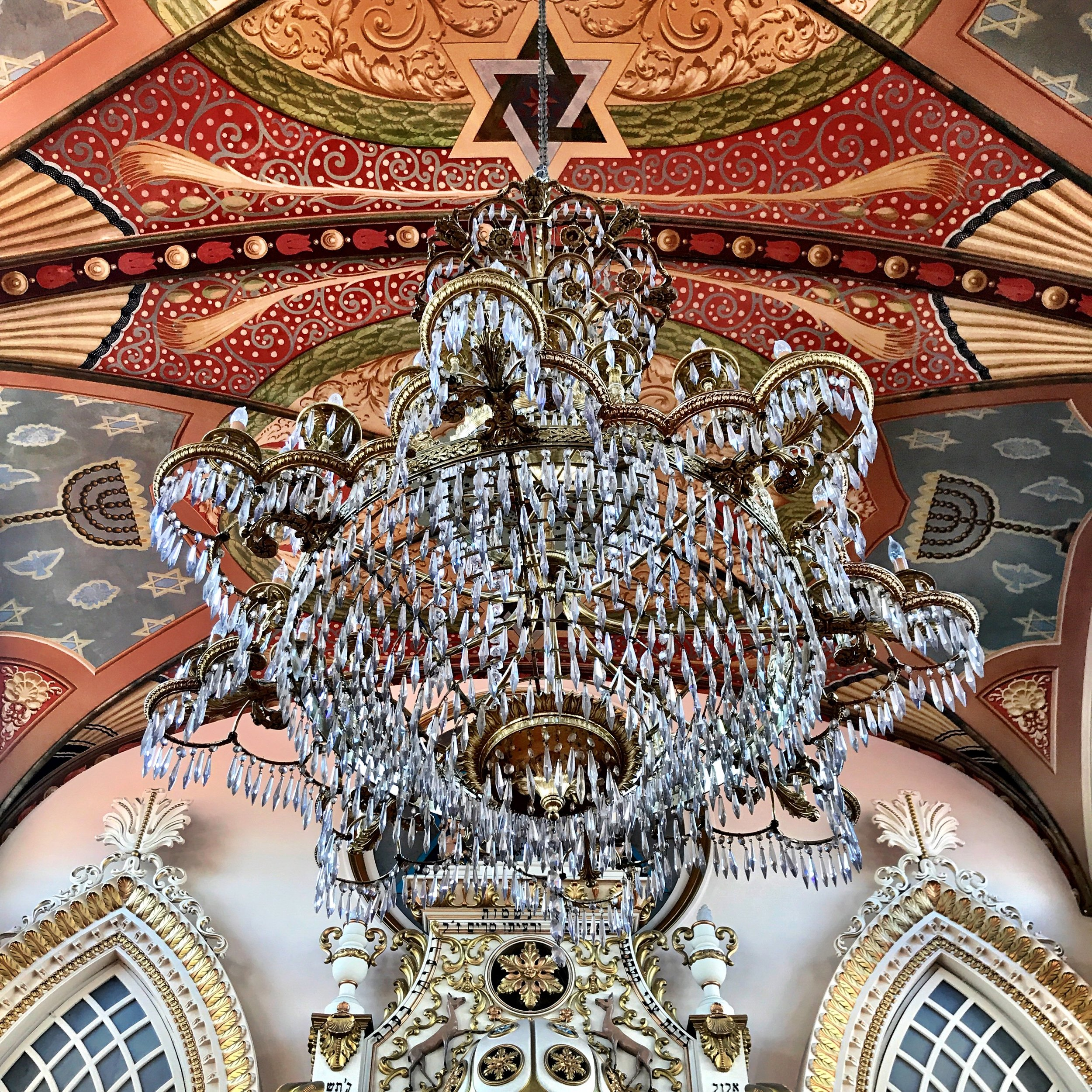 A chandelier hangs above the holy ark