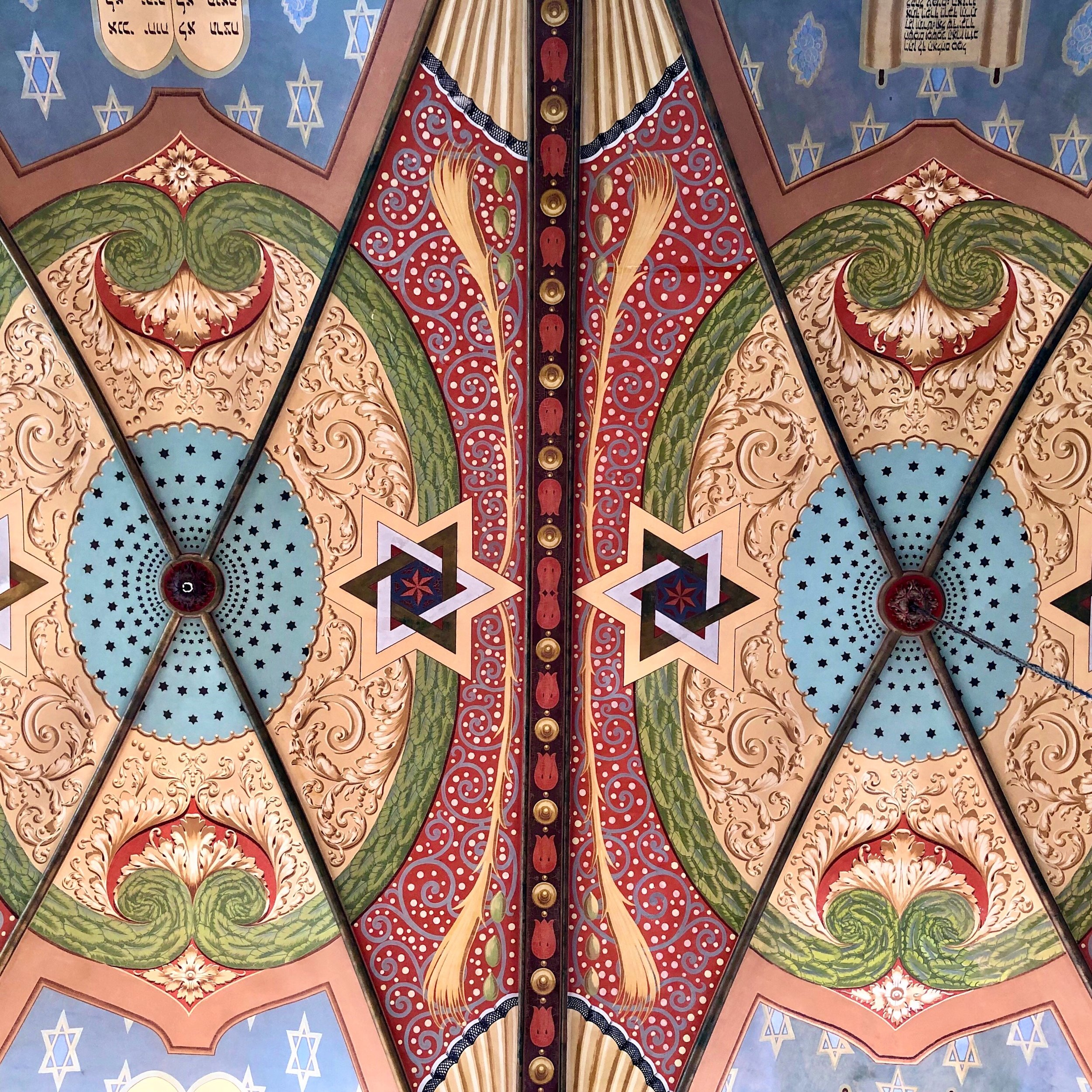 Look up to see the folk art-styled ceiling, with its gorgeous color pallette