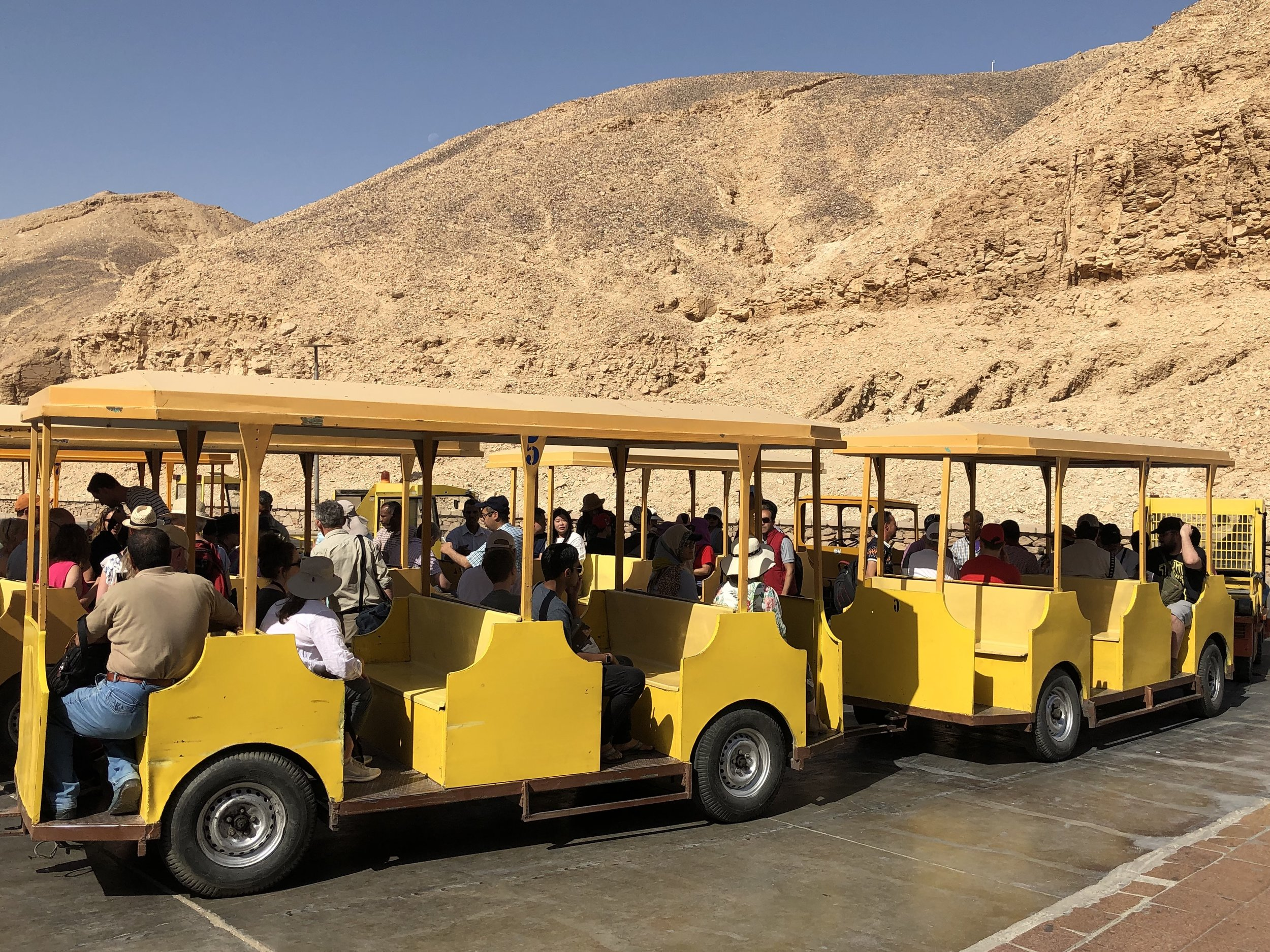 You can take one of these cute little yellow trams to get to the archeological site