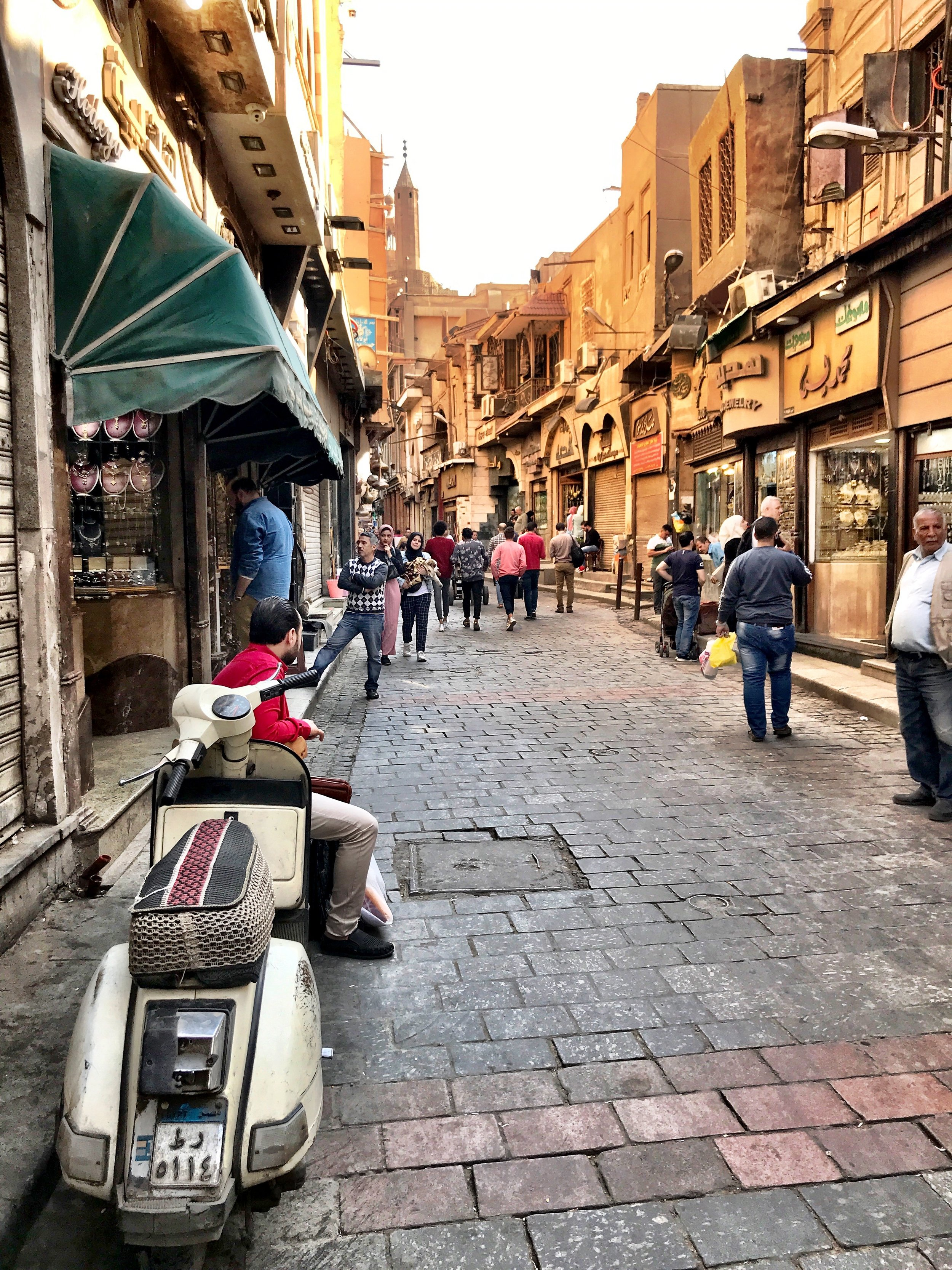 Motorbikes whizz through the souk — as it got dark, one almost ran right into Duke!