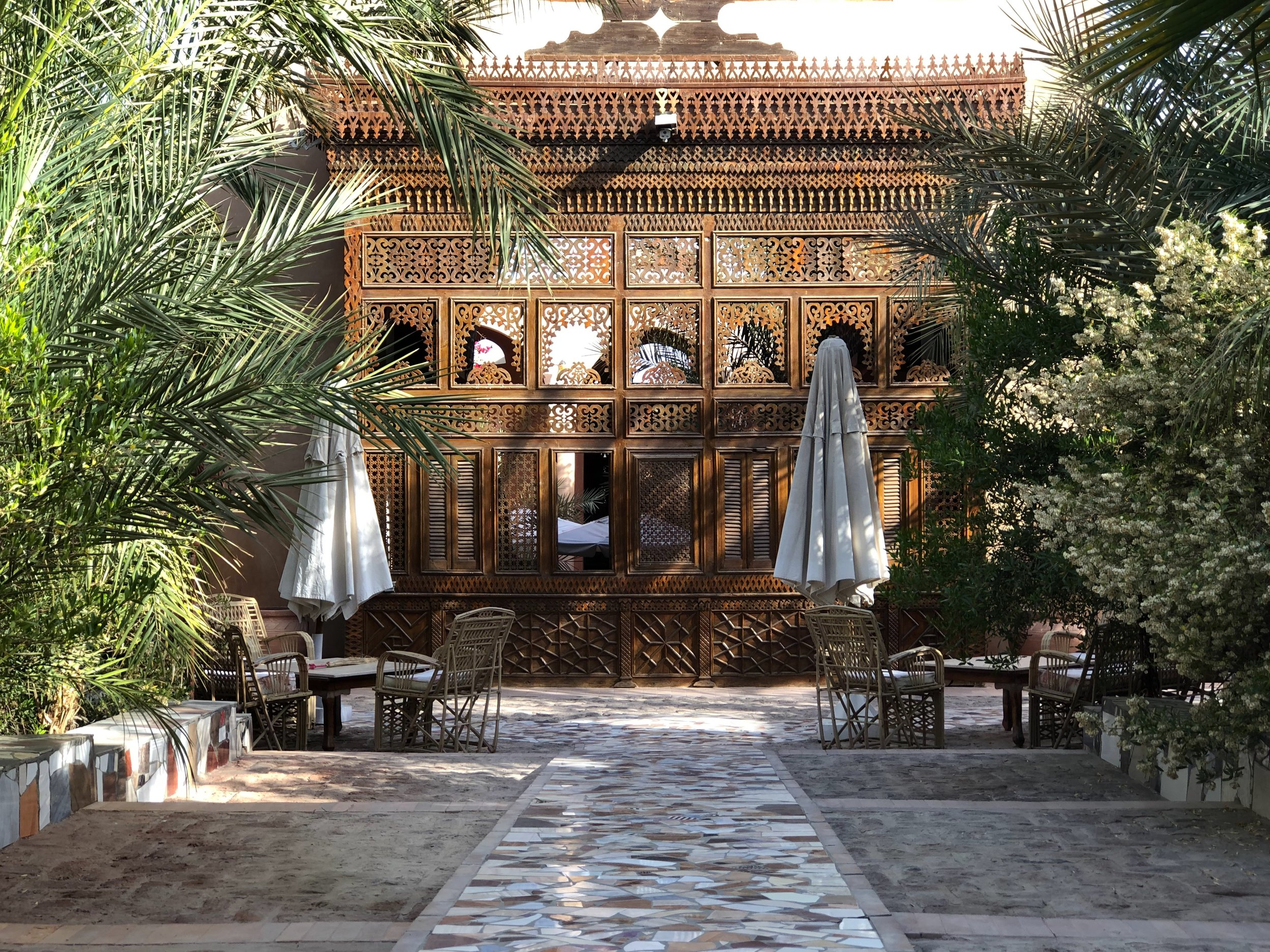 This elaborate woodwork forms one wall of the central courtyard