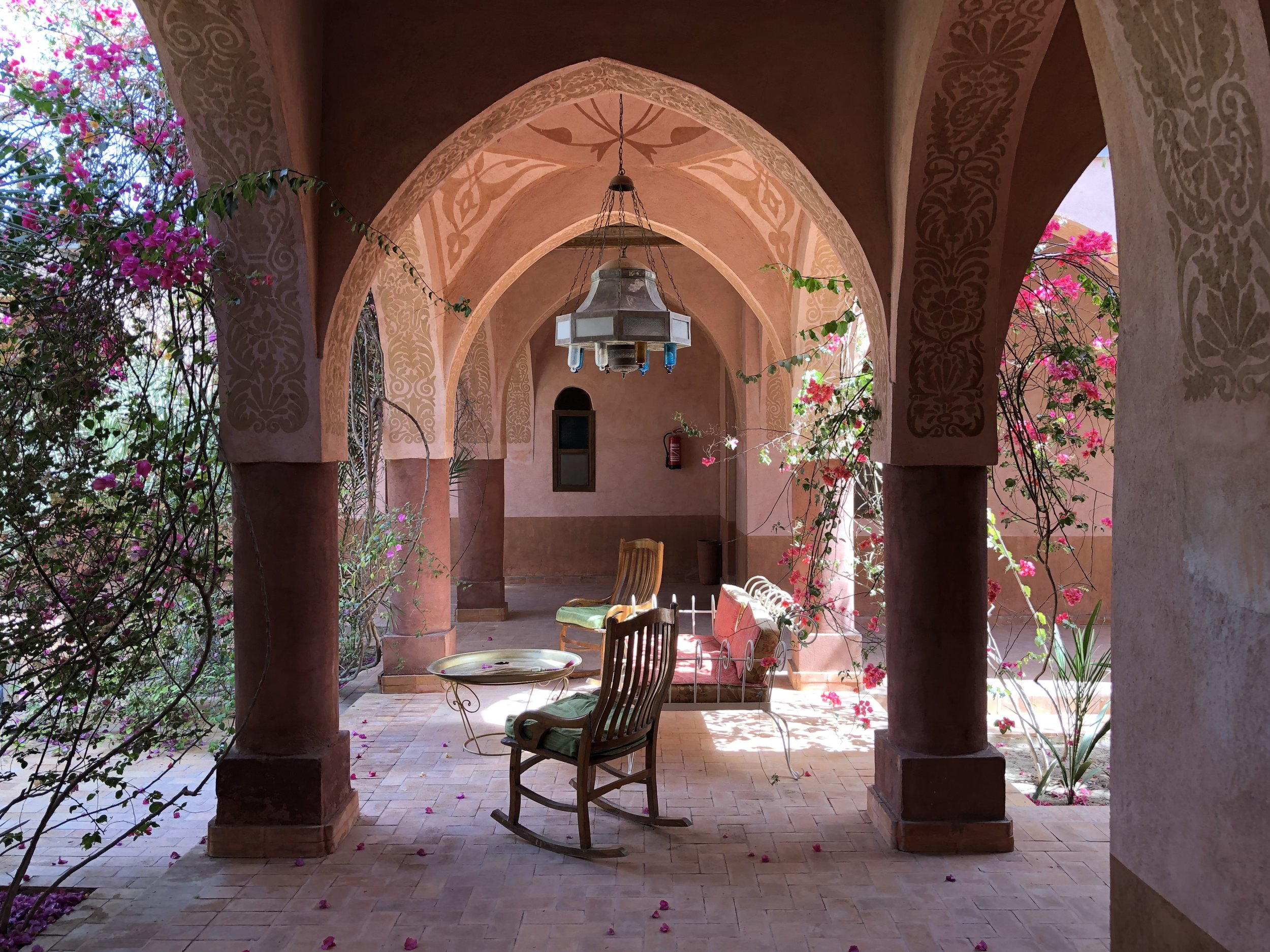 Our room opened to a courtyard filled with vibrant flowering bougainvillea, a fountain, and a sitting area