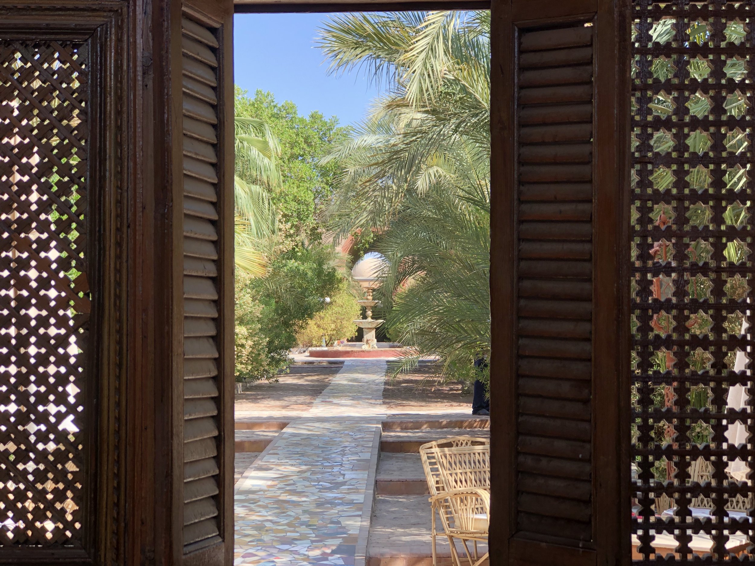 Garden paths made of repurposed tile meander throughout Al Moudira