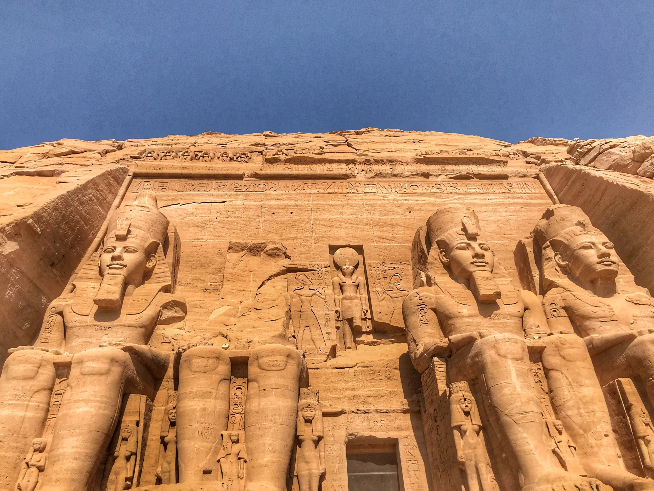 It's a family affair at Abu Simbel — those smaller statues at the bottom are Ramesses' wife, mother and children