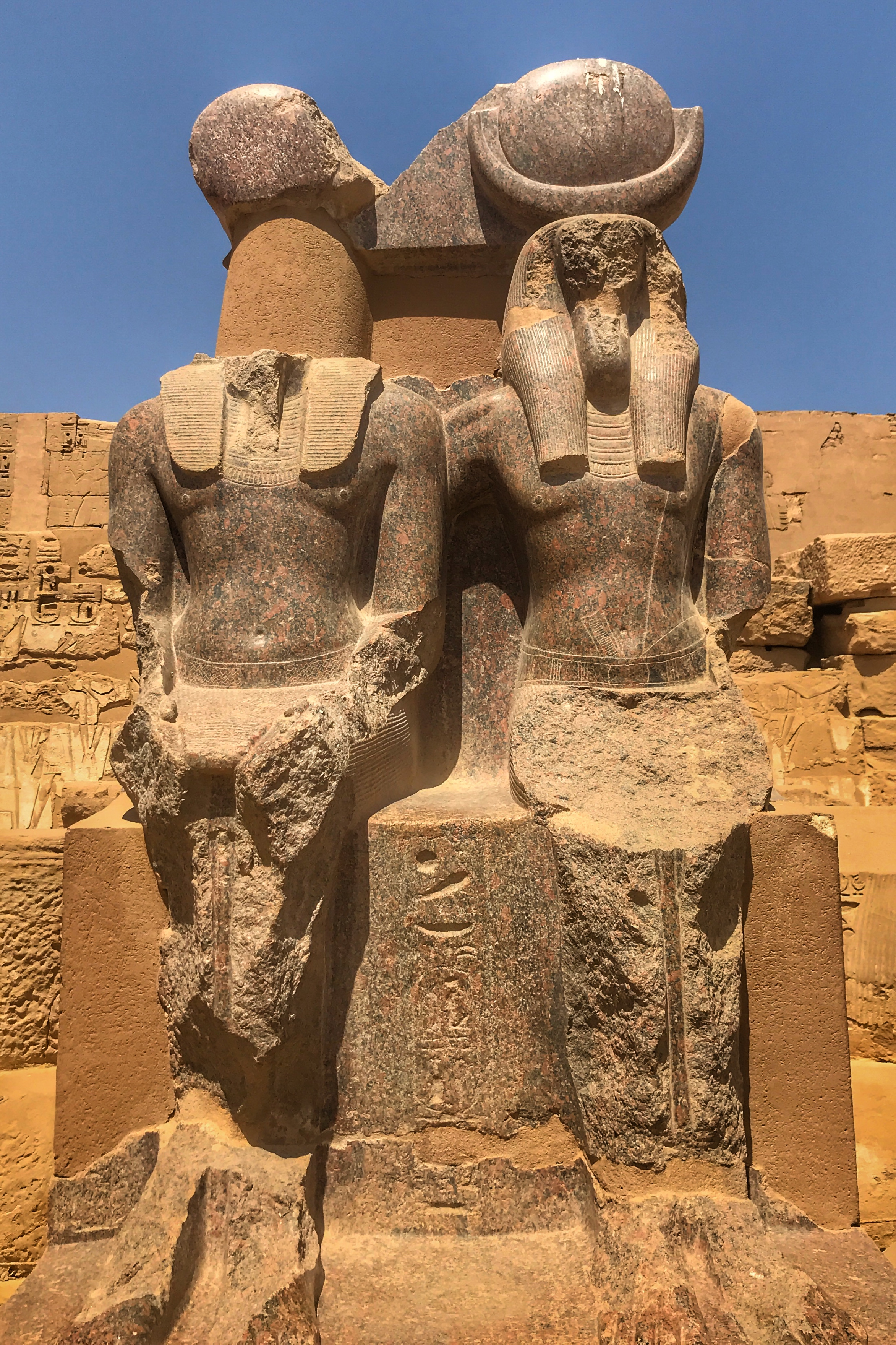 There are four rose granite statues at the very back of the complex. They depict Ramesses III with Maat, the goddess of truth and justice, and Thoth, the god of wisdom