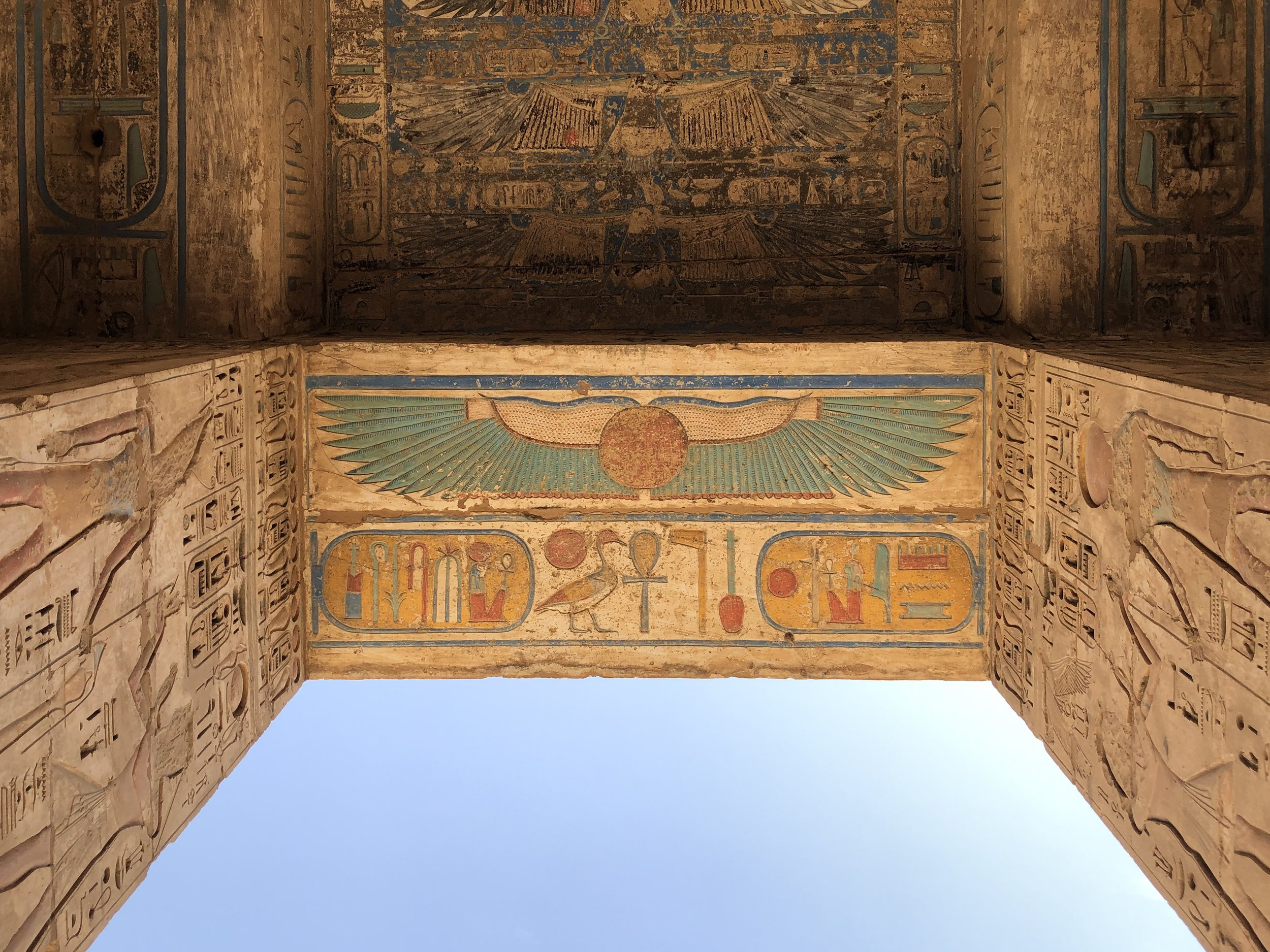 The underside of this gateway shows the winged sun amongst other paintings