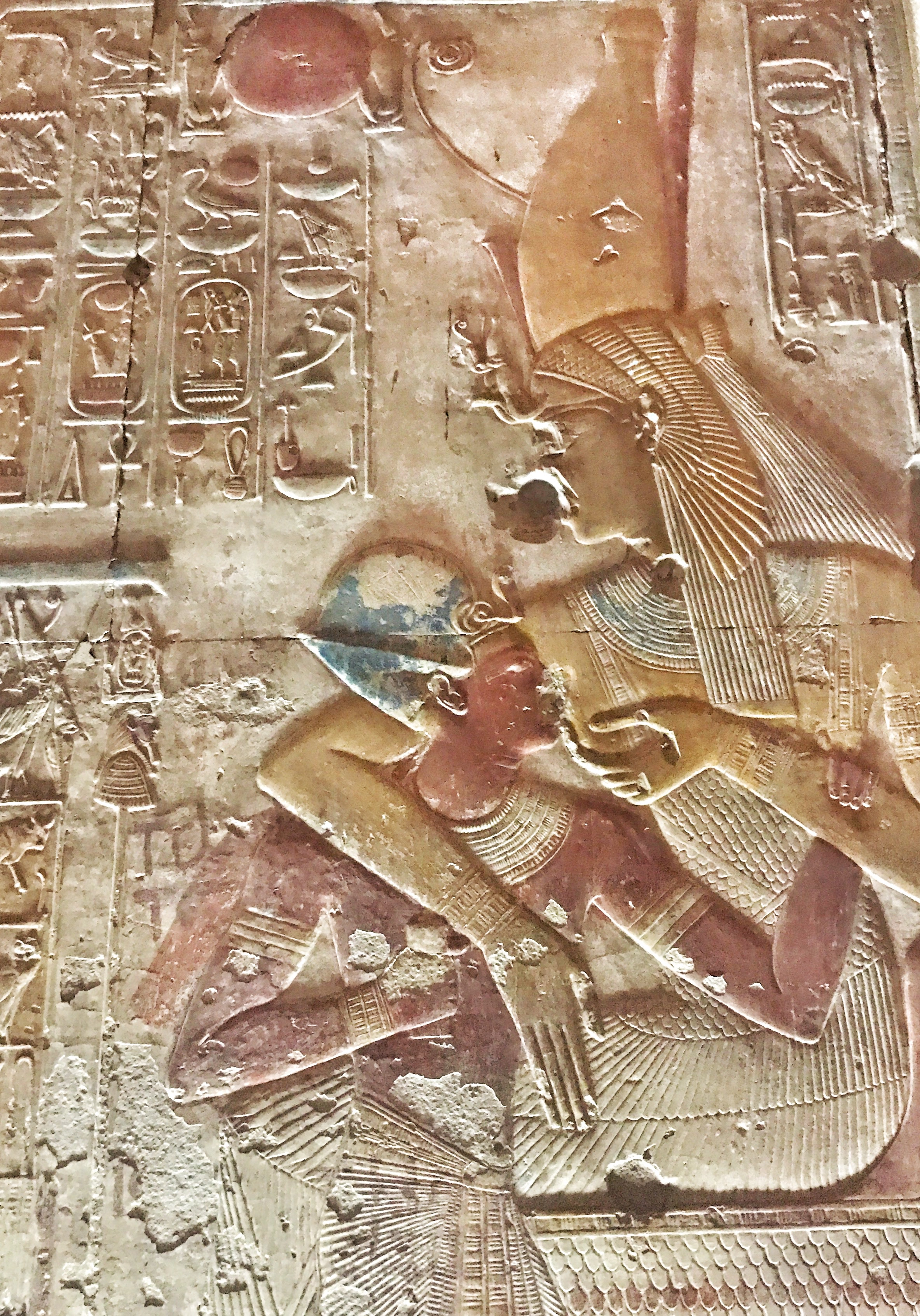 Isn't he getting a bit old for that? Horus suckles on his mother Isis' breast