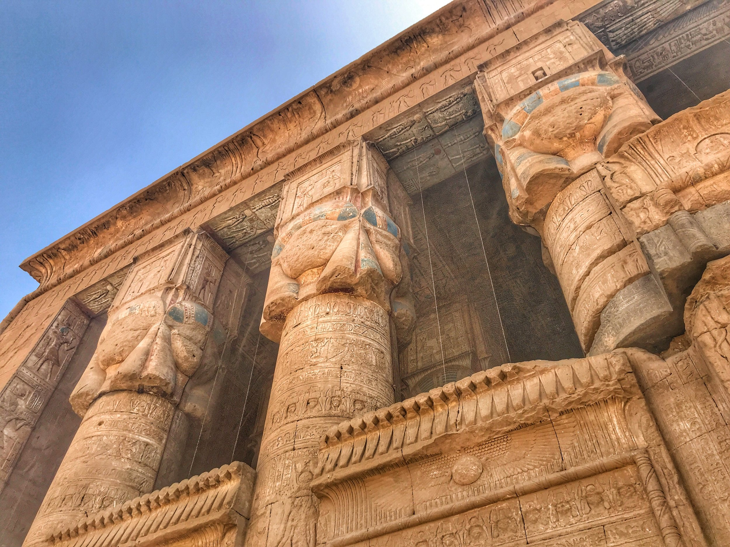 The exterior of the Temple of Hathor glows in the bright sunlight