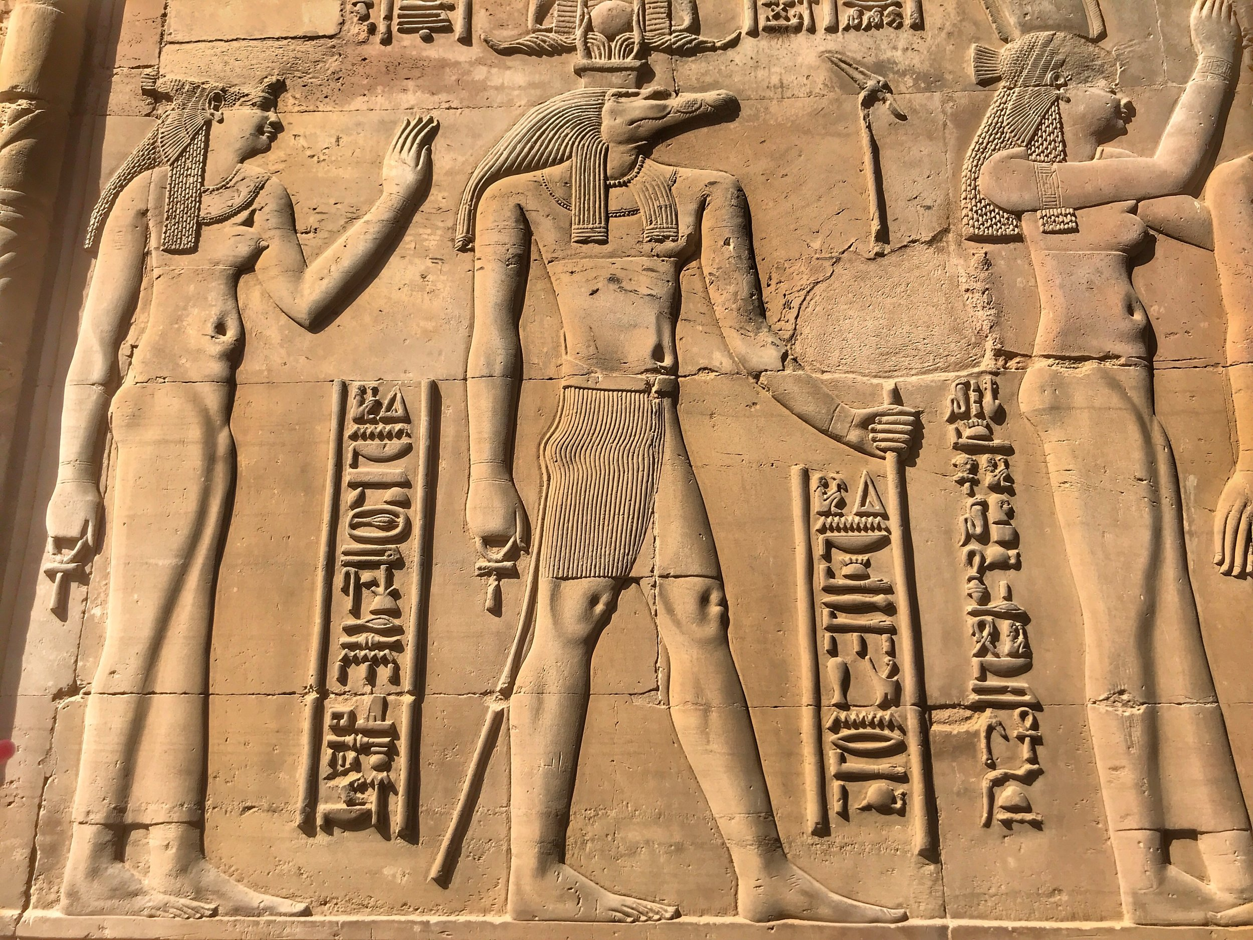 Crocodile-headed Sobek, seen in the middle, is a complicated god of water and fertility